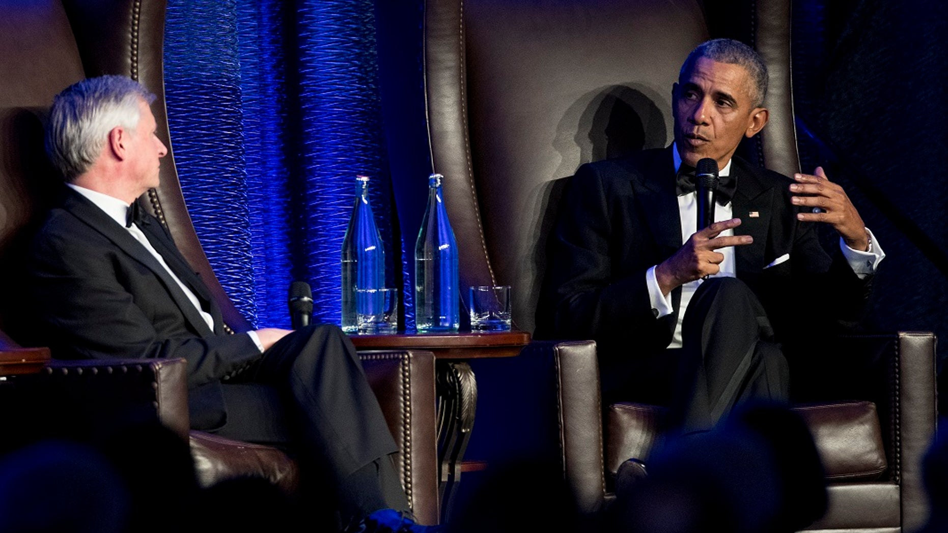 Former President Barack Obama talks with Jon Meacham during the celebration of the 25th Anniversary Gala of the Baker Institute for Public Policy at Rice University.