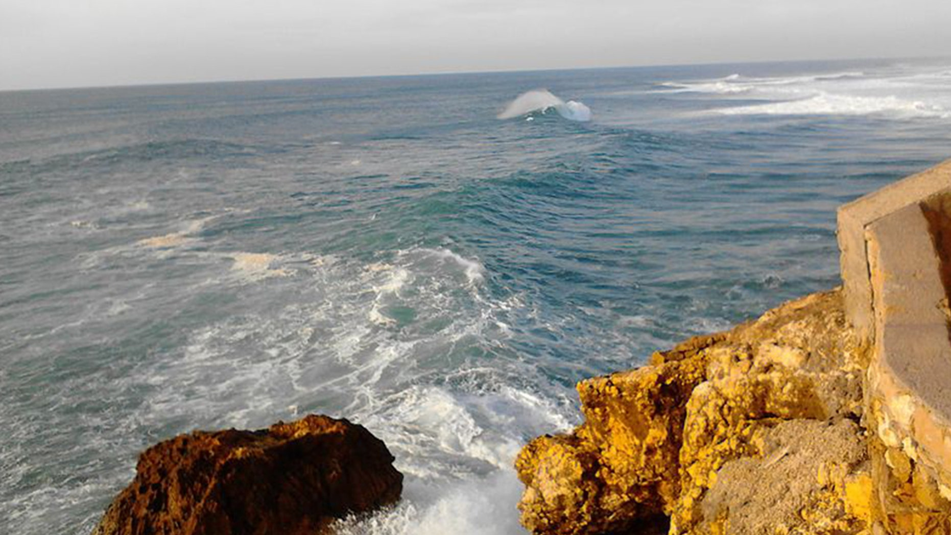 Pictured is the Praia do Norte in Nazare in Portugal where a German man died Monday base jumping after his parachute did not open.