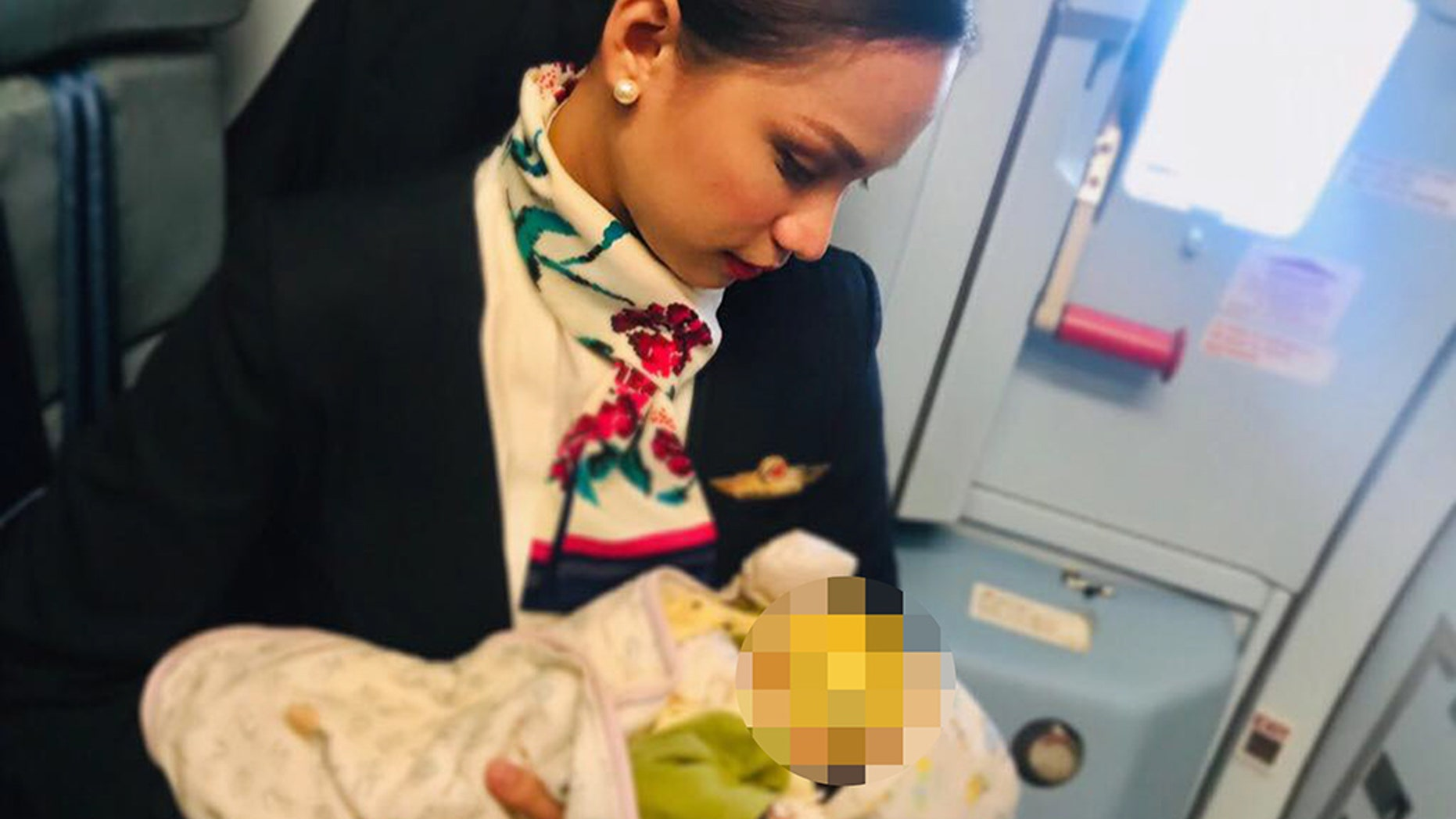 Flight attendant breastfeeds hungry infant inflight