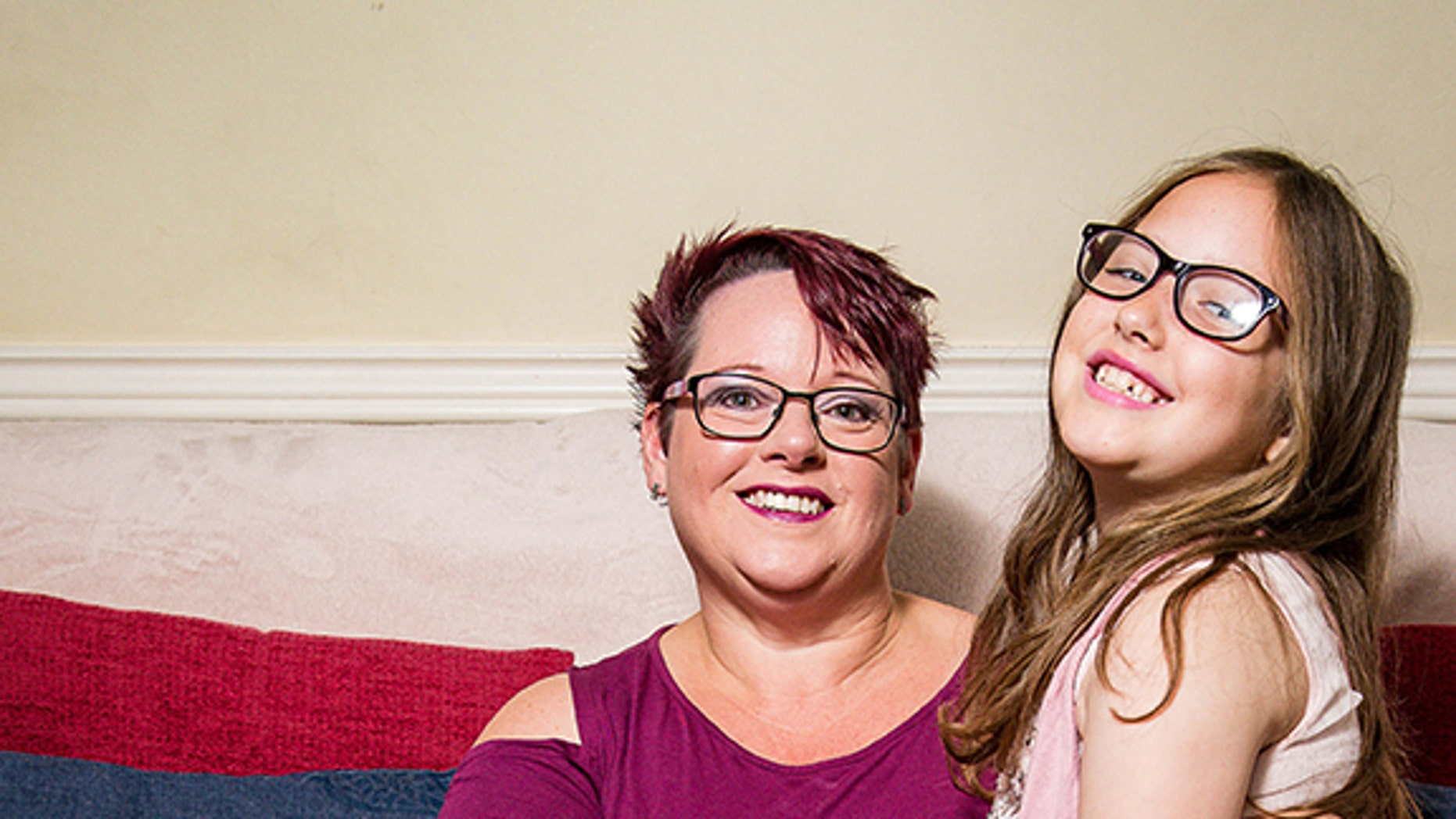 Sharon Spink, 50, pictured with her 9-year-old daughter Charlotte, who she continued to breastfeed until recently.