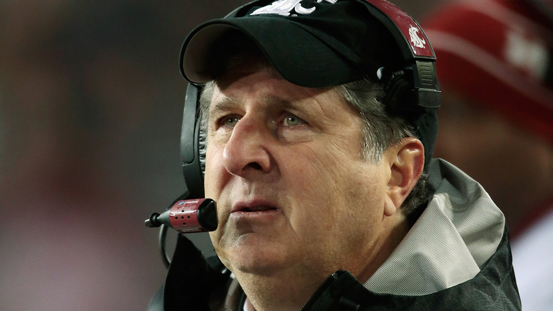 A Washington State official said head coach Mike Leach, pictured, cost the school $  1.6 million over an Obama tweet.