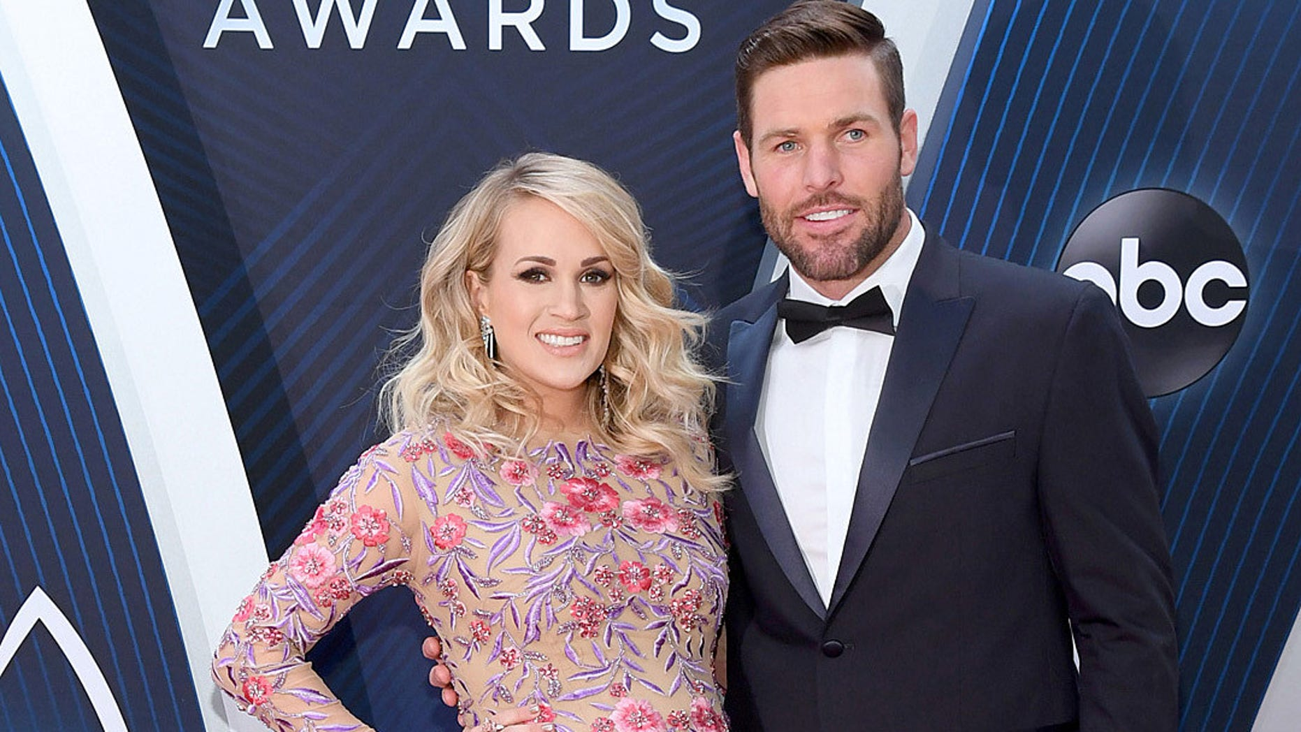 Carrie Underwood and husband Mike Fisher attend the 2018CMA Awards.