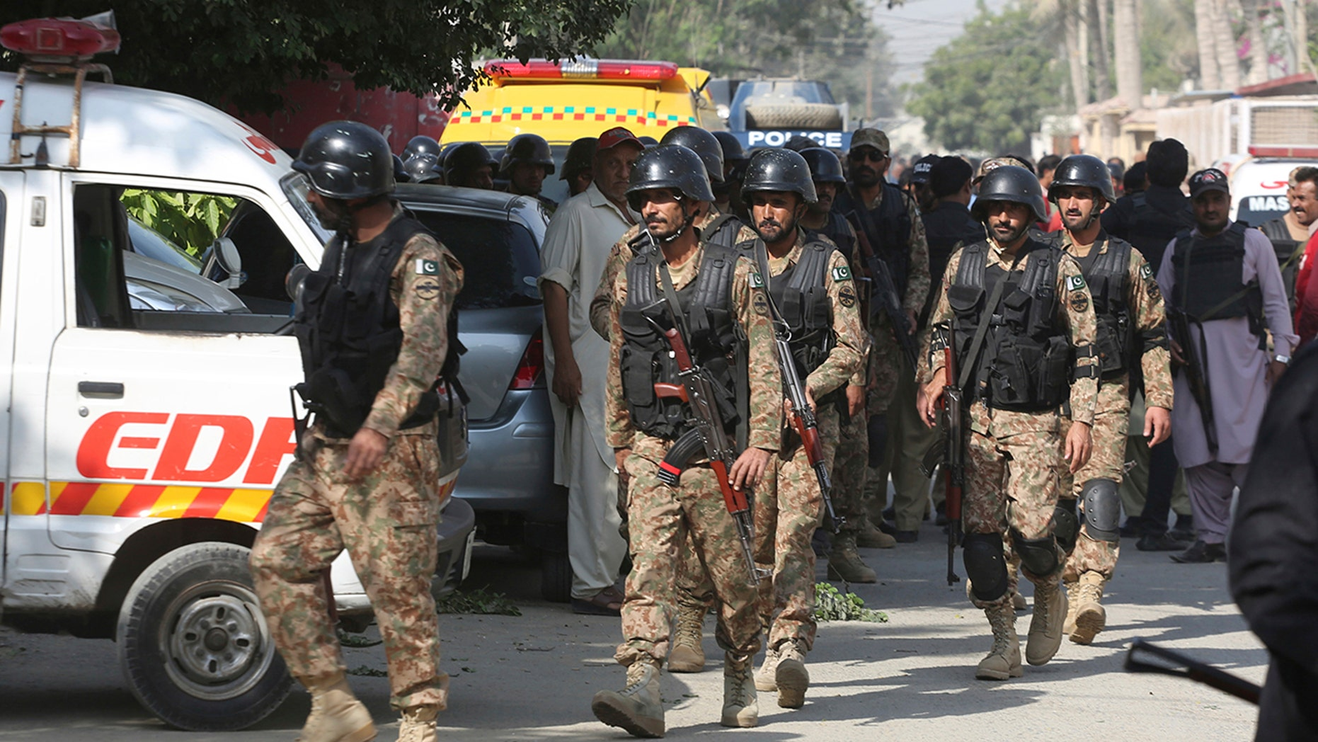 Pakistani security personnel arrive at the Chinese Consulate in Karachi, Pakistan, Friday, Nov. 23, 2018. (AP Photo/Shakil Adil)