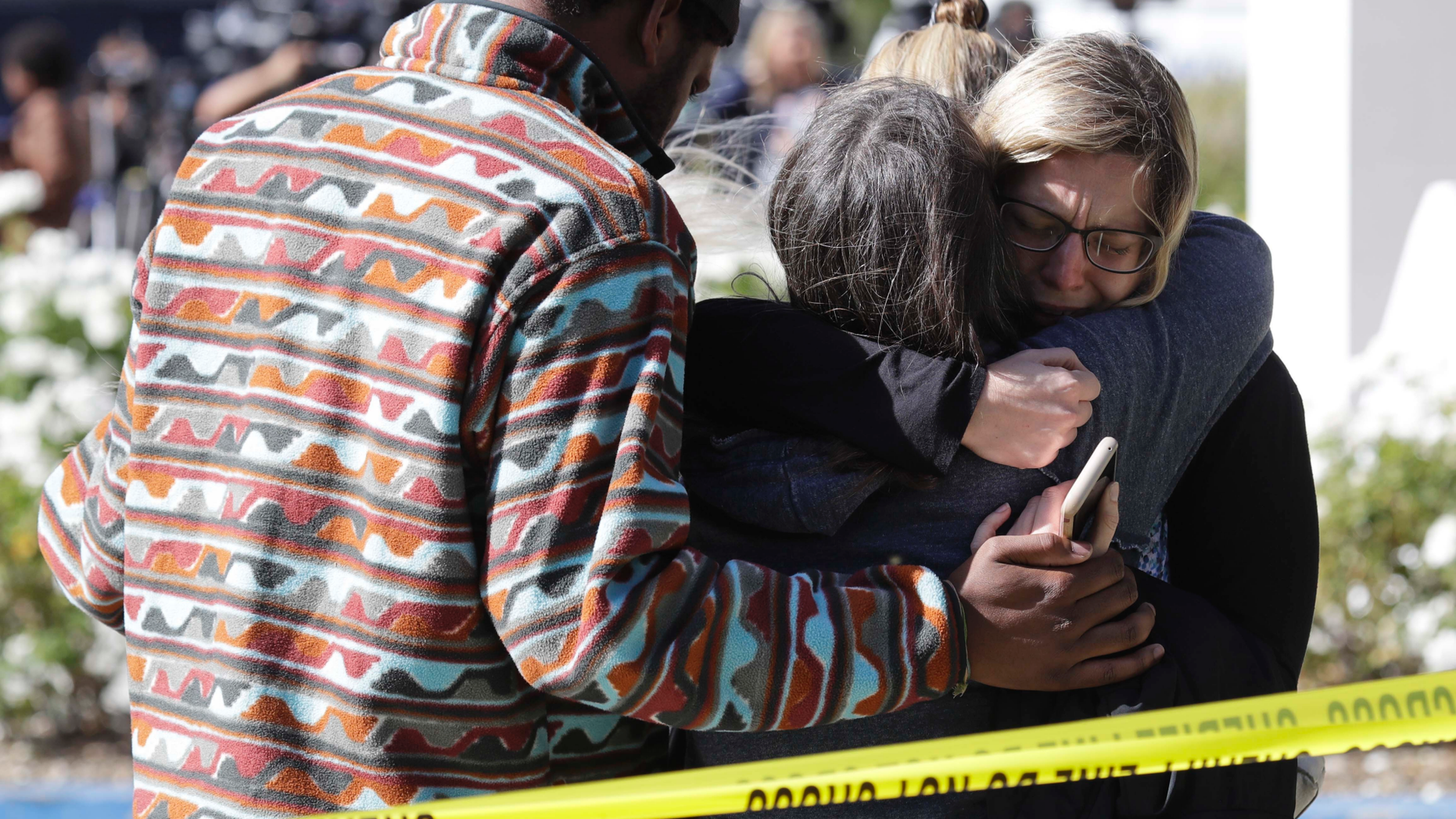 Mourners embrace outside of the Thousand Oaks Teen Center, where relatives and friends gathered in the aftermath of a mass shooting, Thursday, Nov. 8, 2018, in Thousand Oaks, Calif. Multiple people were shot and killed late Wednesday by a gunman who opened fire at the Borderline Bar & Grill, which was holding a weekly country music dance night for college students. (AP Photo/Marcio Jose Sanchez)