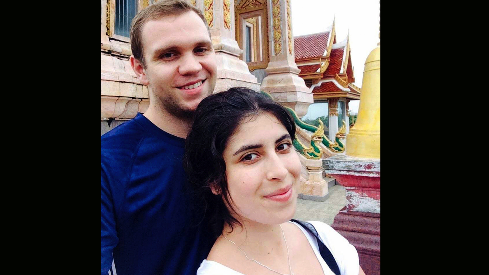 FILE - In this undated family photo, showing Matthew Hedges with his wife Daniela Tejada. The 31-year-old British academic Matthew Hedges was arrested May 5, 2018, at Dubai Airport and subsequently convicted and sentenced to life in prison for espionage. The United Arab Emirates Ambassador in London Sulaiman Hamid Almazroui said Friday Nov. 23, 2018, that his government is studying whether to grant clemency to Hedges. (Daniela Tejada via AP, FILE)