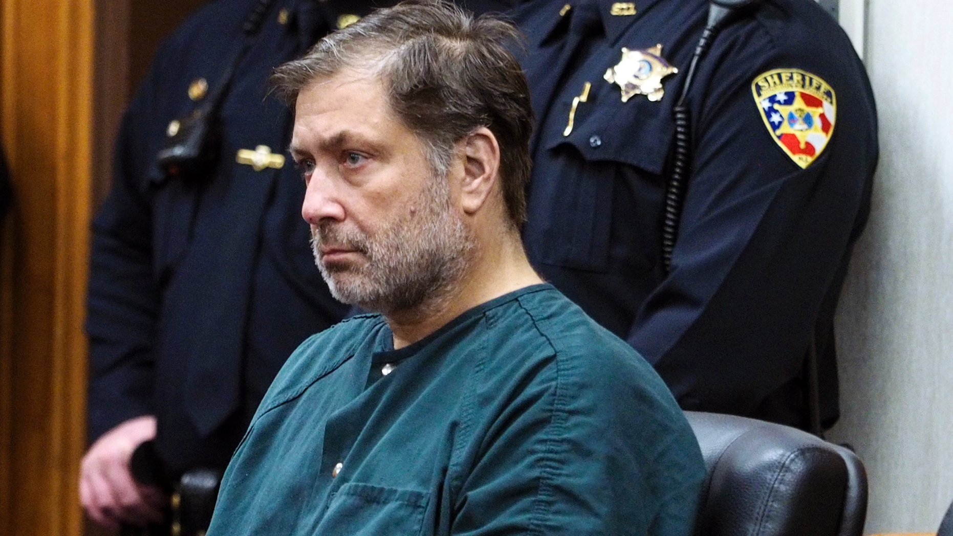 Paul Caneiro appears in Monmouth County Superior Court for a detention hearing on Friday, Nov. 30, 2018 in Freehold, N.J. Caneiro, 51, faces four counts of murder, along with arson and weapons charges, in the deaths of his brother Keith; Keith's wife, Jennifer; their 11-year-old son, Jesse; and their 8-year-old daughter, Sophia.  (Patti Sapone/NJ Advance Media via AP, Pool)