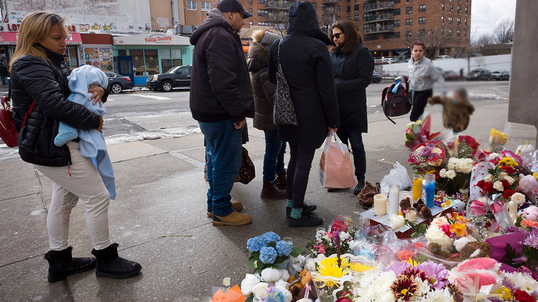 In this March 8, 2018 file photo, people gather at a sidewalk memorial for two children who were killed the previous week when they were struck by a car driven by a woman who likely had a seizure behind the wheel, in the Park Slope neighborhood of the Brooklyn borough of New York. Dorothy Bruns was found dead in her home in Staten Island borough of New York on Tuesday, Nov. 6.