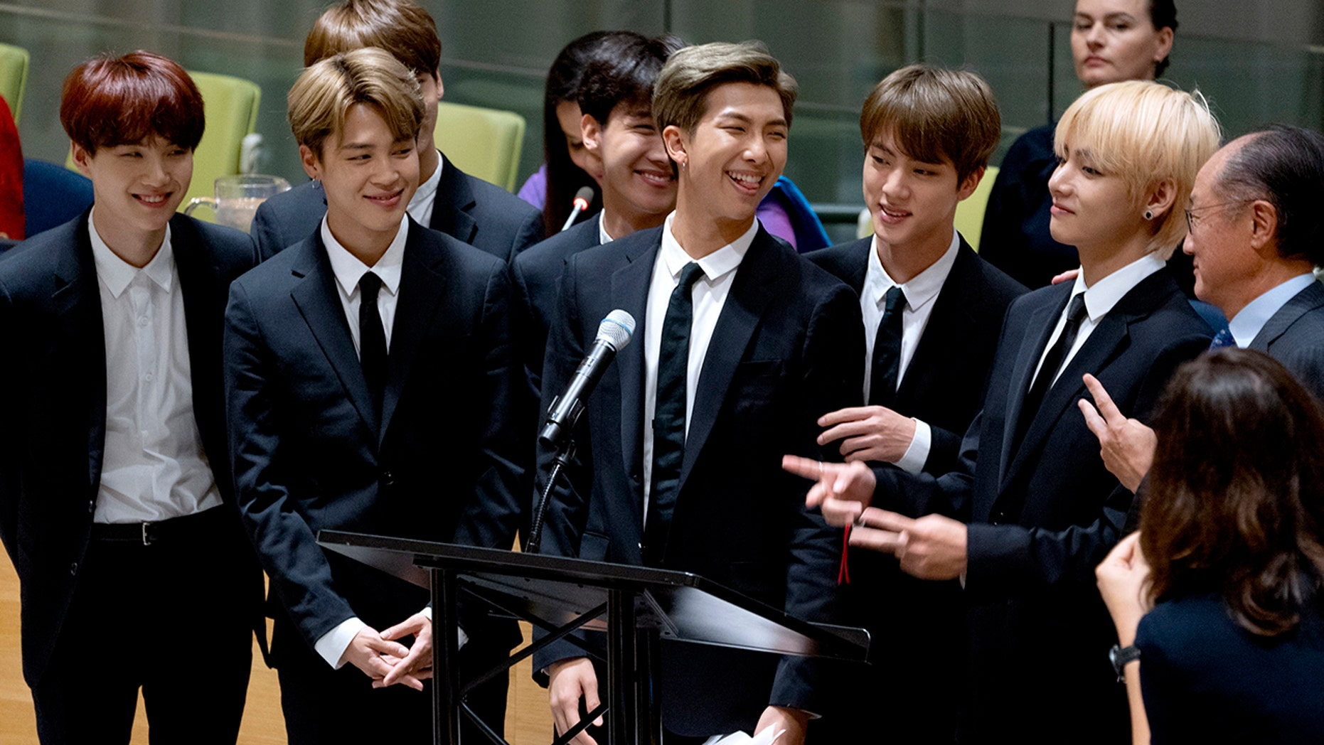 A Japanese broadcaster canceled a live TV appearance of the Korean band BTS after a photo went viral of a band member wearing a T-shirt showing an atomic bombing juxtaposed with the celebration of Korea's liberation from Japan after World War II.