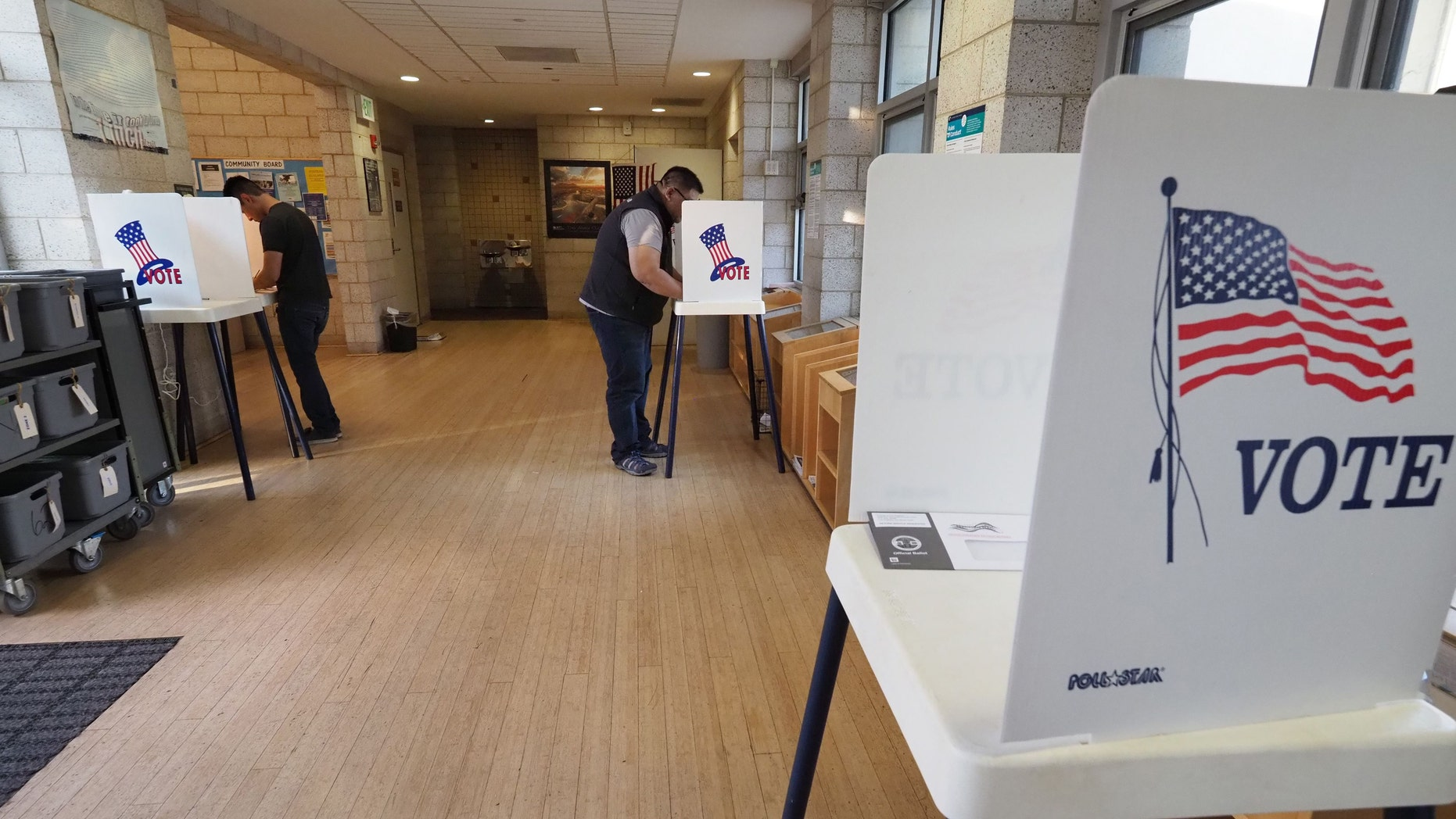 File photo - People complete their ballot during early voting for the mid-term elections at a public library in the Lake View Terrace neighborhood of Los Angeles, California on Nov. 4, 2018.