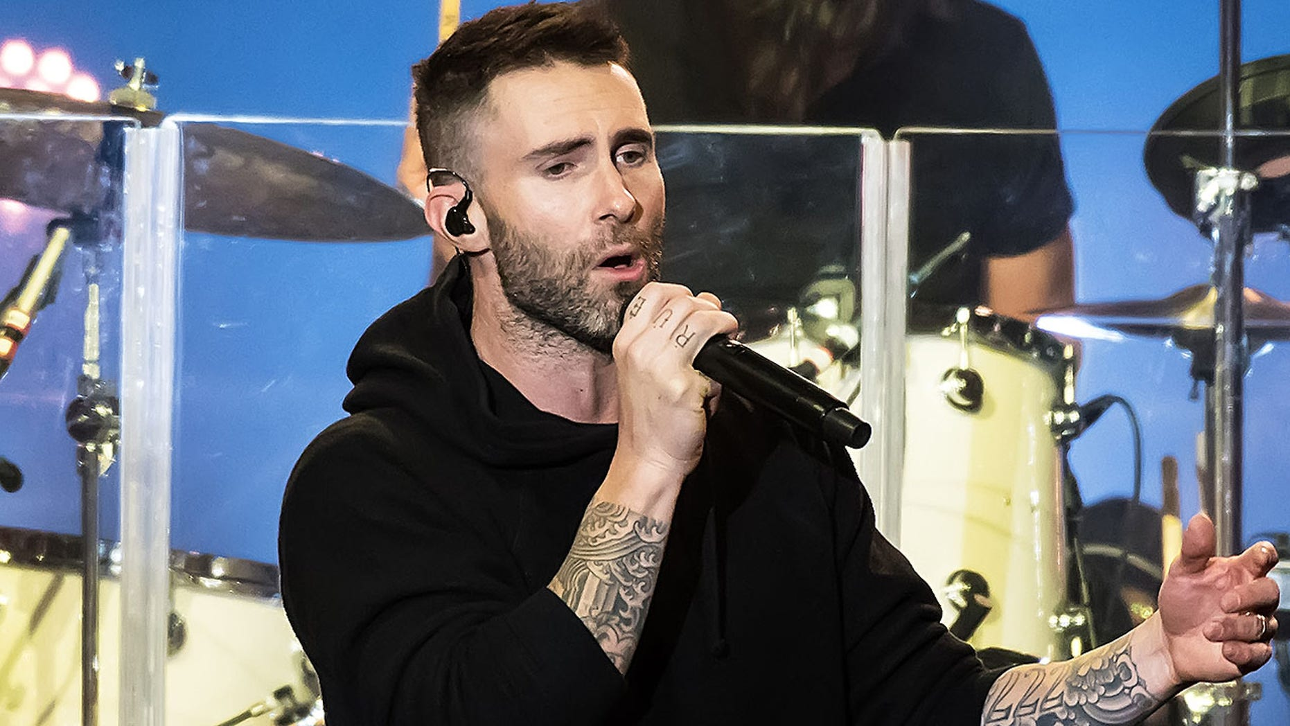 "Adam Levine of Maroon 5 is still under fire for making a last-minute plea against one of his own team members during last week's ""The Voice."""