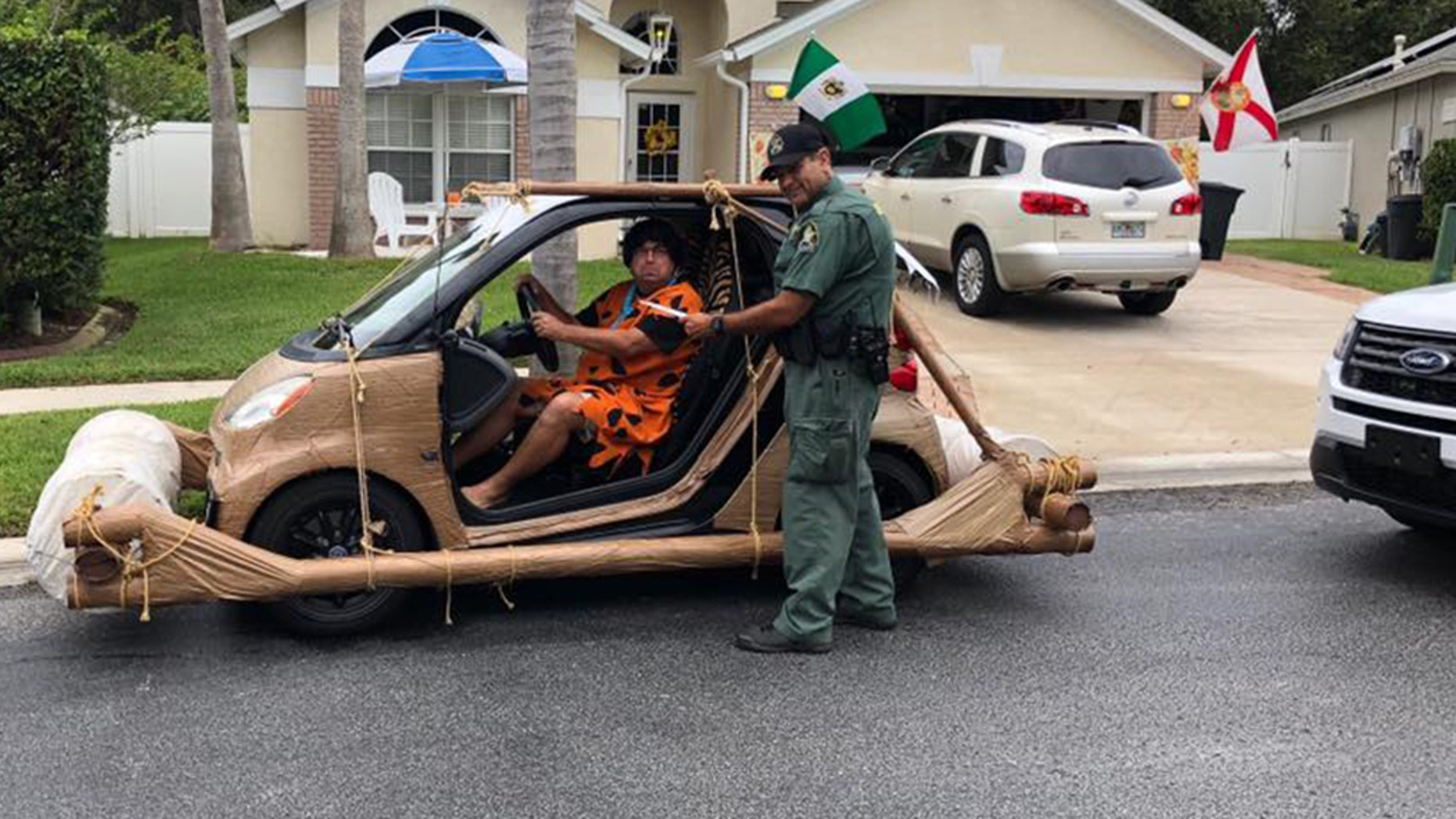 """A man driving a Flinstone """"foot mobile"""" was pulled over and """"ticketed"""" by police earlier this month."""