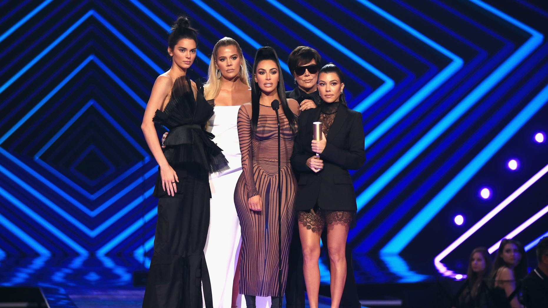 Kendall Jenner, Khloe Kardashian, Kim Kardashian West, Kris Jenner, and Kourtney Kardashian accept The Reality Show of 2018 award for 'Keeping Up with the Kardashians' on stage during the 2018 E! People's Choice Awards.