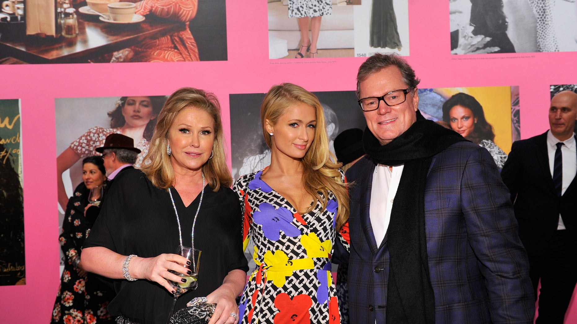 Kathy Hilton, Paris Hilton, wearing Diane Von Furstenberg, and Rick Hilton attend Diane Von Furstenberg's Journey of A Dress Exhibition Opening Celebration at May Company Building at LACMA West.