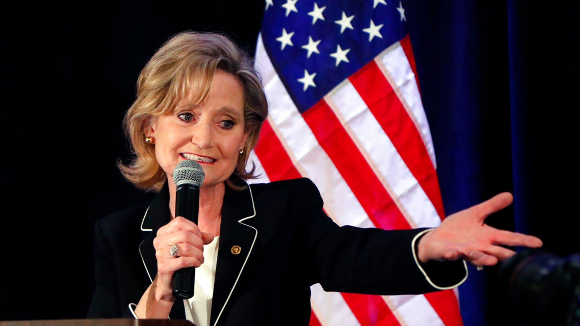 Republican U.S. Sen. Cindy Hyde-Smith celebrates her runoff win over Democrat Mike Espy in Jackson, Miss., Tuesday, Nov. 27, 2018. Hyde-Smith will now serve the final two years of retired Republican Sen. Thad Cochran's six year term. (AP Photo/Rogelio V. Solis)