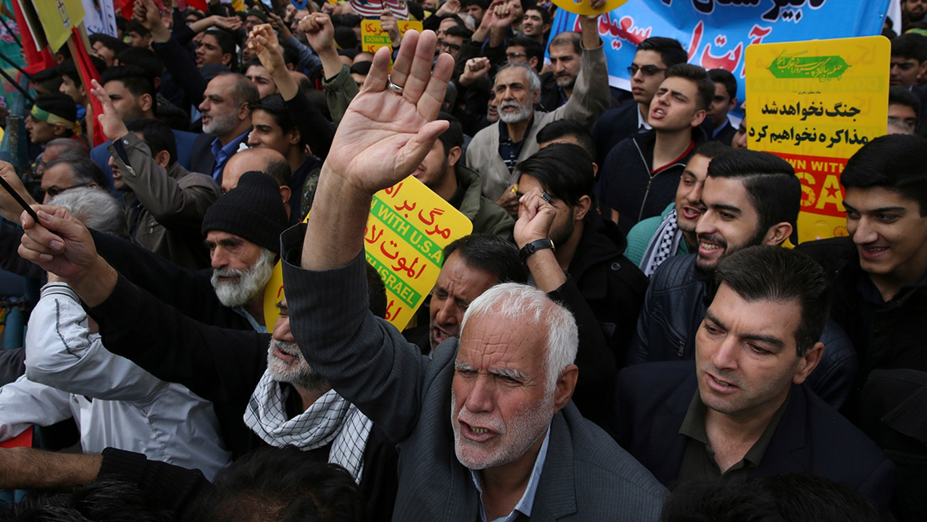 Demonstrators chant slogans during an annual rally in front of the former U.S. Embassy in Tehran, Iran, on Sunday, Nov. 4, 2018, to mark the 39th anniversary of the seizure of the embassy by militant Iranian students.