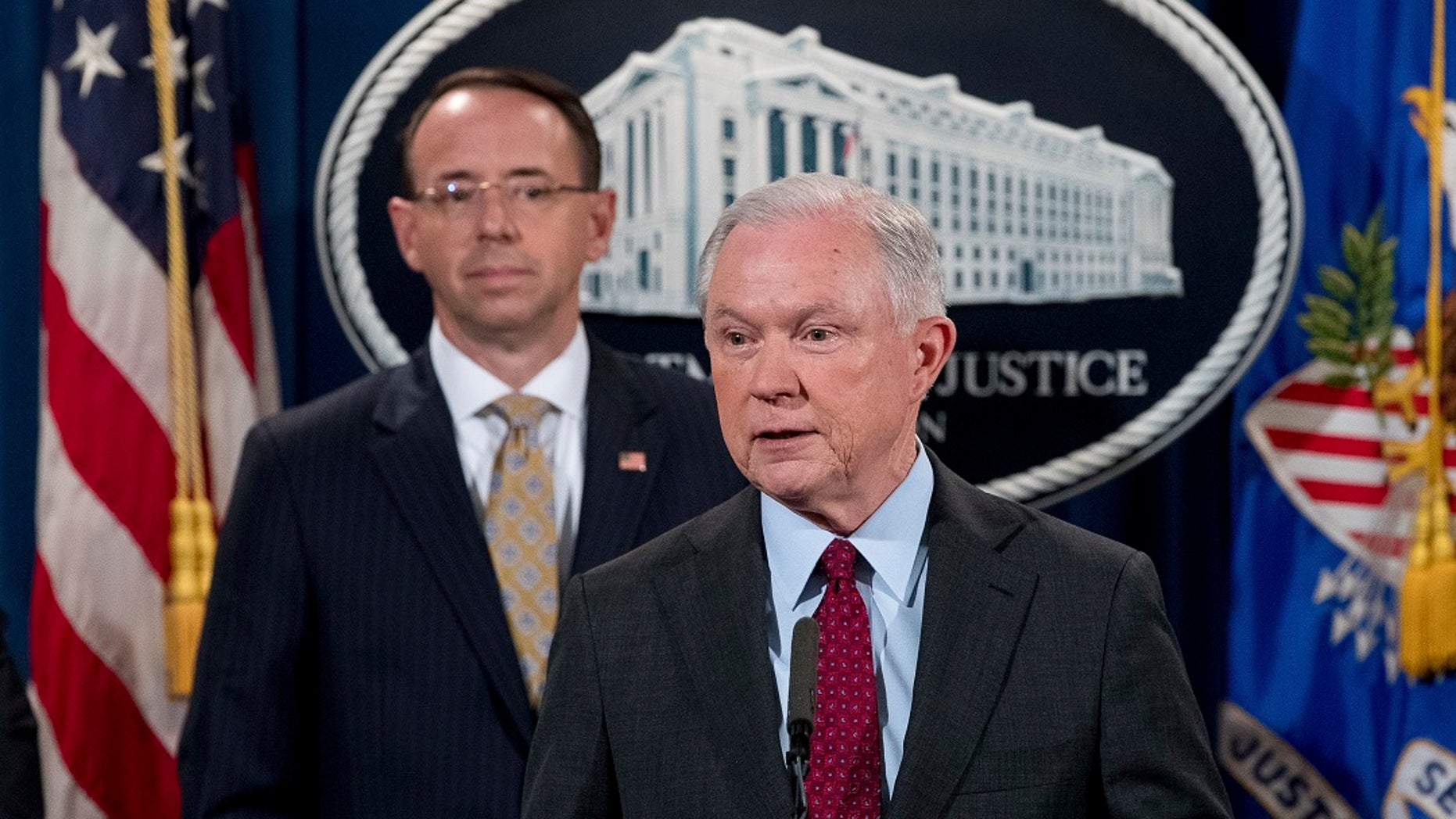 FILE - Attorney General Jeff Sessions accompanied by Deputy Attorney General Rod Rosenstein, speaks at a news conference at the Justice Department in Washington.