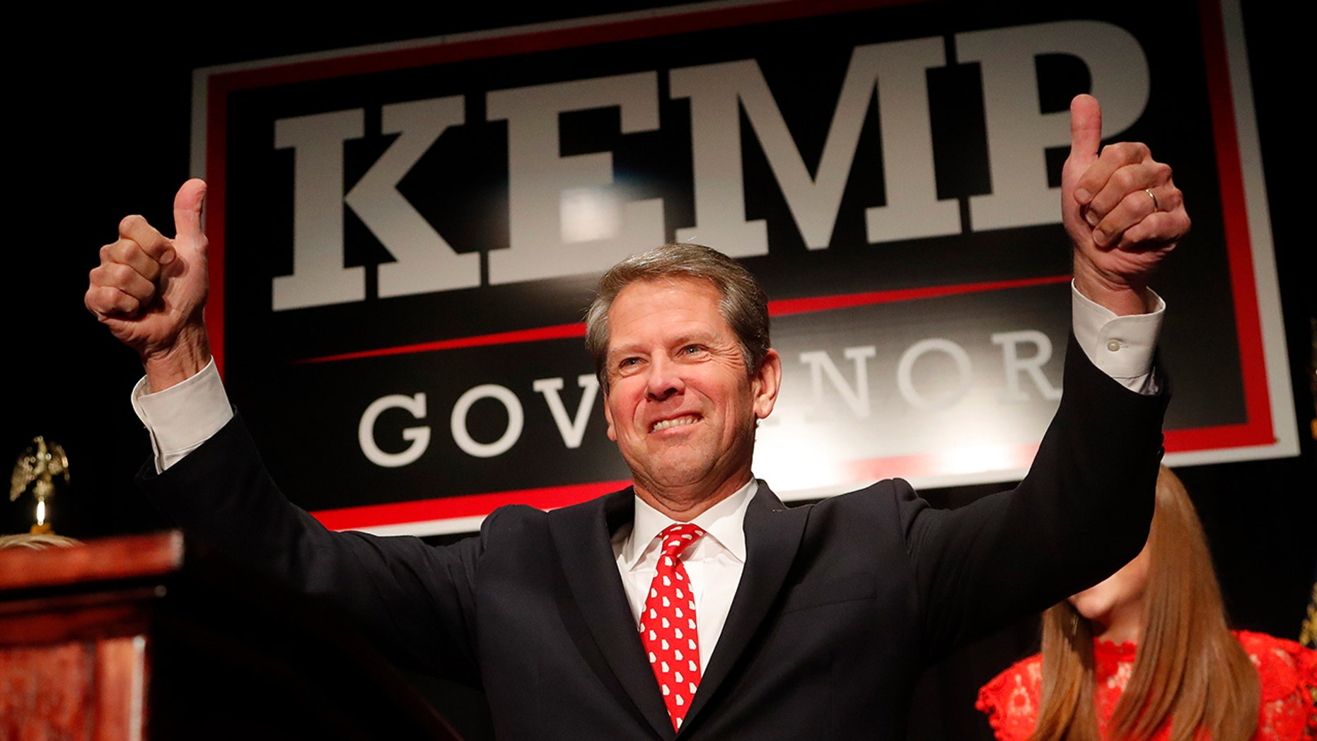 Georgia Republican gubernatorial candidate Brian Kemp gives a thumbs-up to supporters, Wednesday, Nov. 7, 2018, in Athens, Ga. (Associated Press)