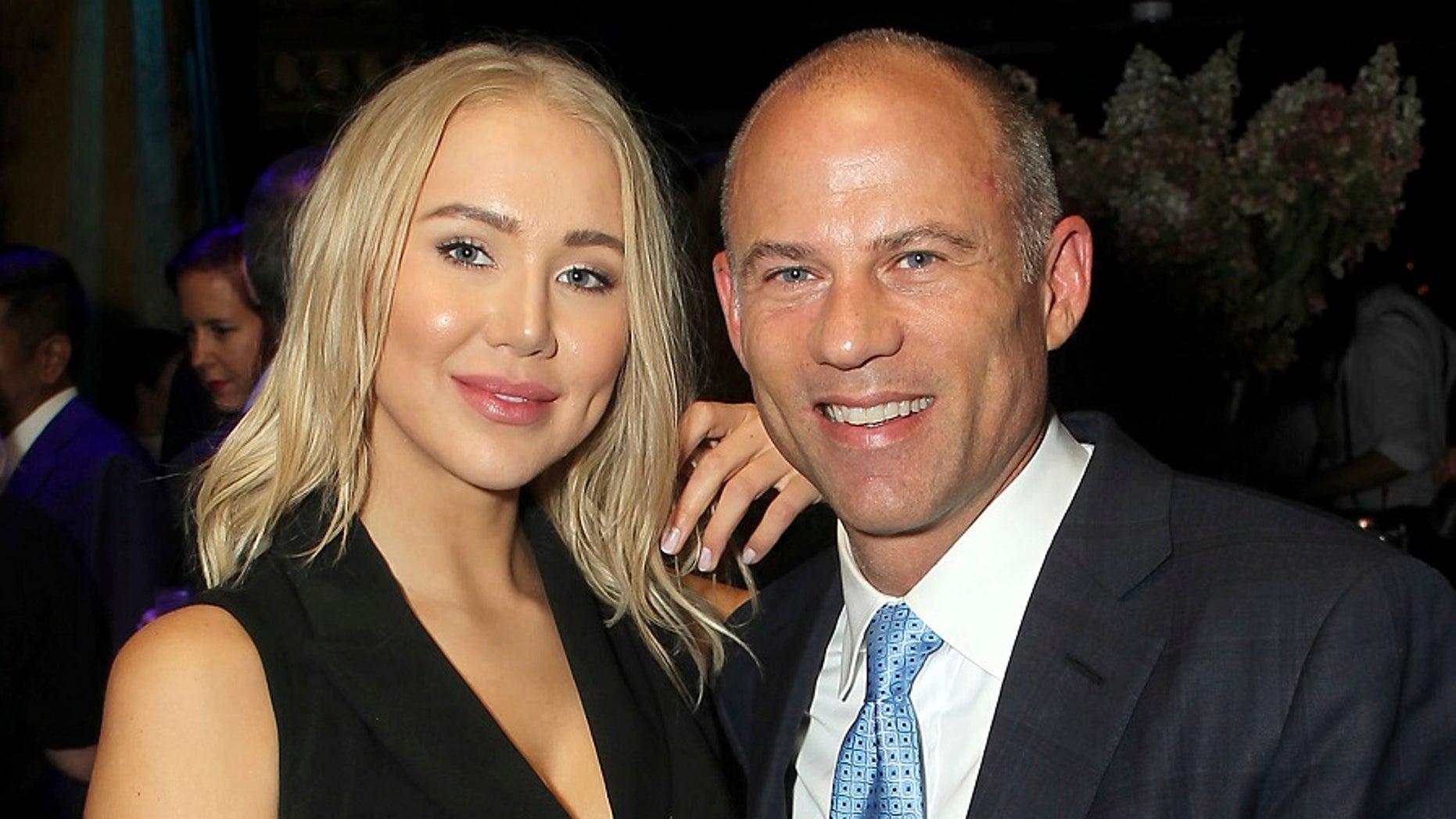 Attorney Michael Avenatti, right, poses with Mareli Miniutti for a photo at a party in New York.