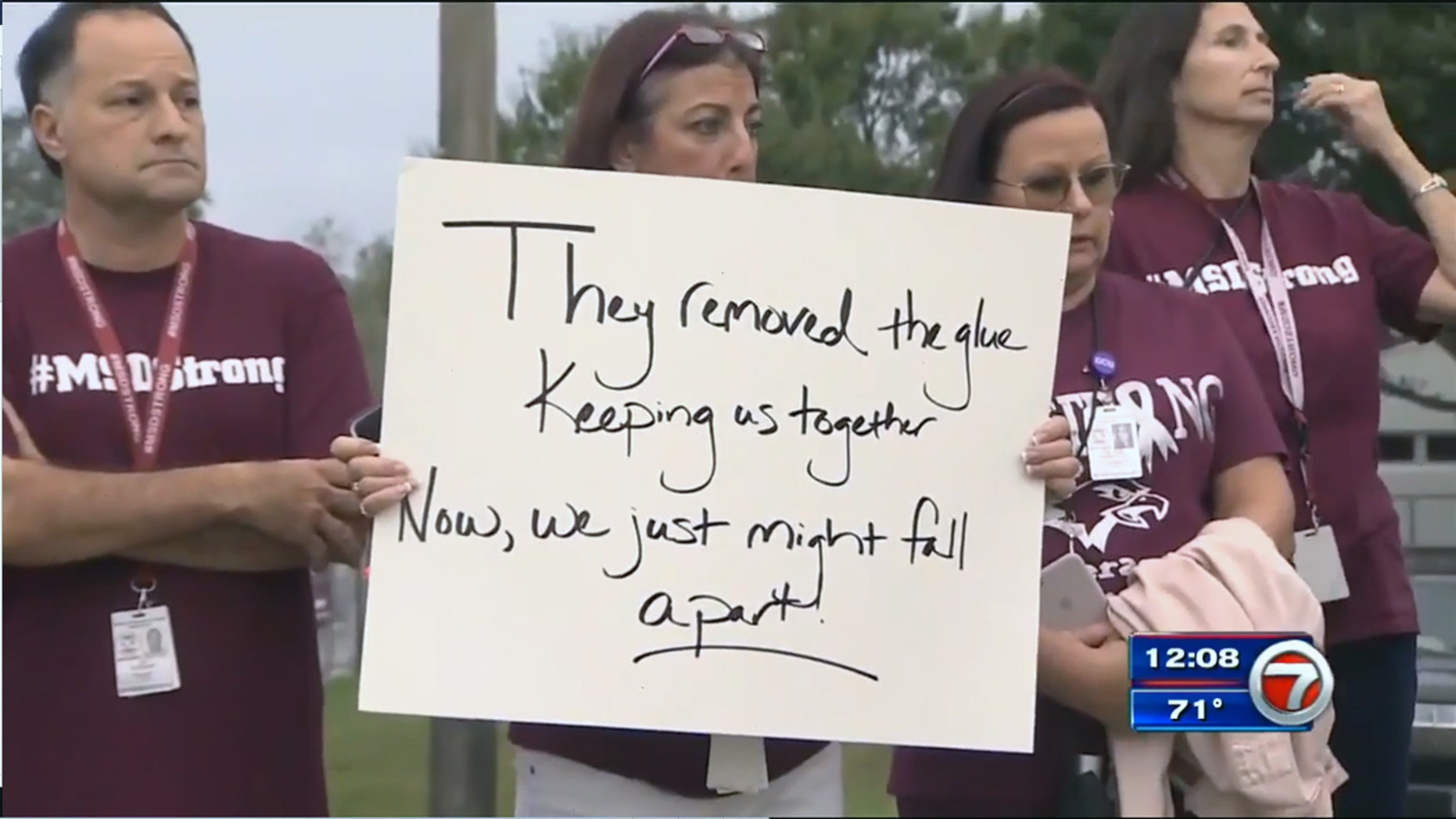 Teachers at Marjory Stoneman Douglas High School protest Tuesday against the reassignment of four directors.