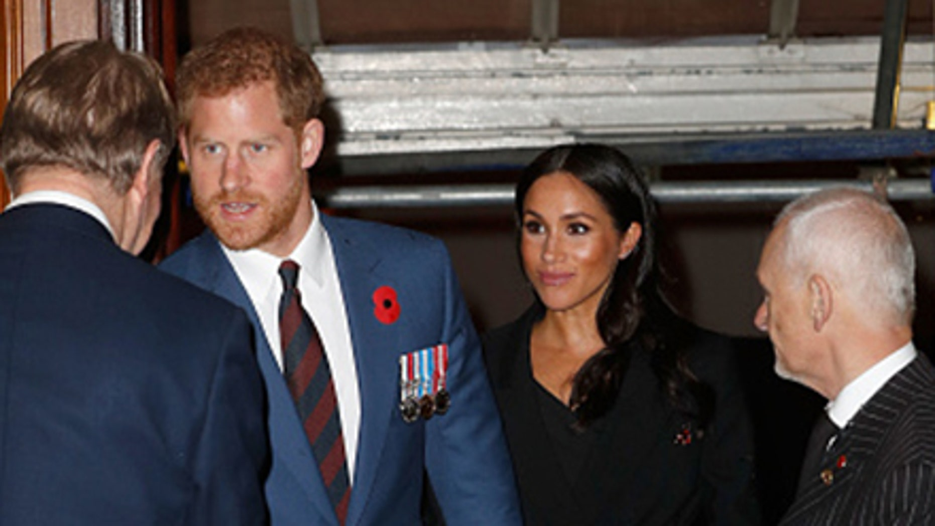 Prince Harry, Duke of Sussex and Meghan, Duchess of Sussex attend the Royal British Legion Festival of Remembrance at the Royal Albert Hall on November 10, 2018 in London, England.