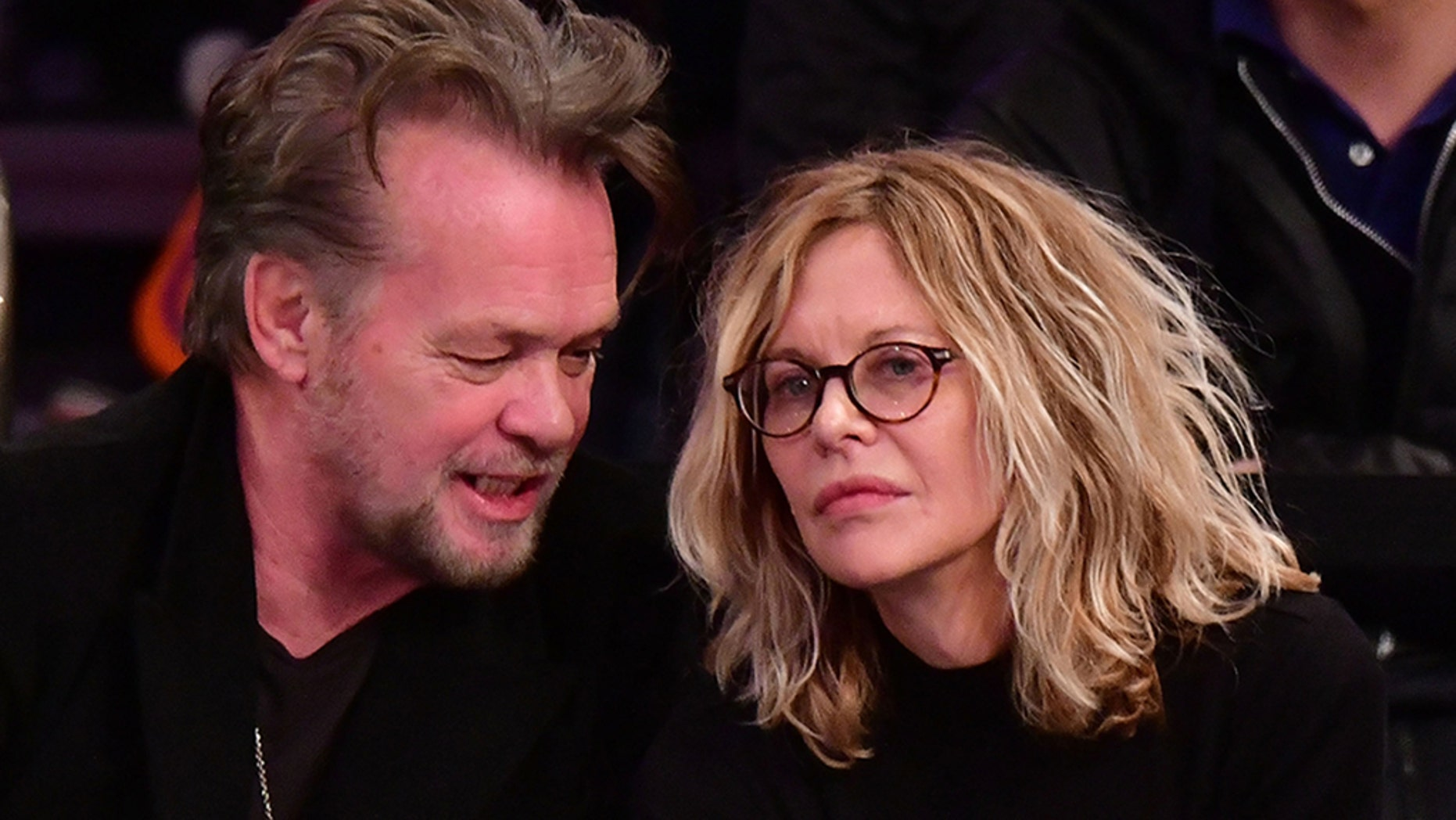 John Mellencamp and Meg Ryan attend the New York Knicks Vs Philadelphia 76ers game at Madison Square Garden on December 25, 2017 in New York City.