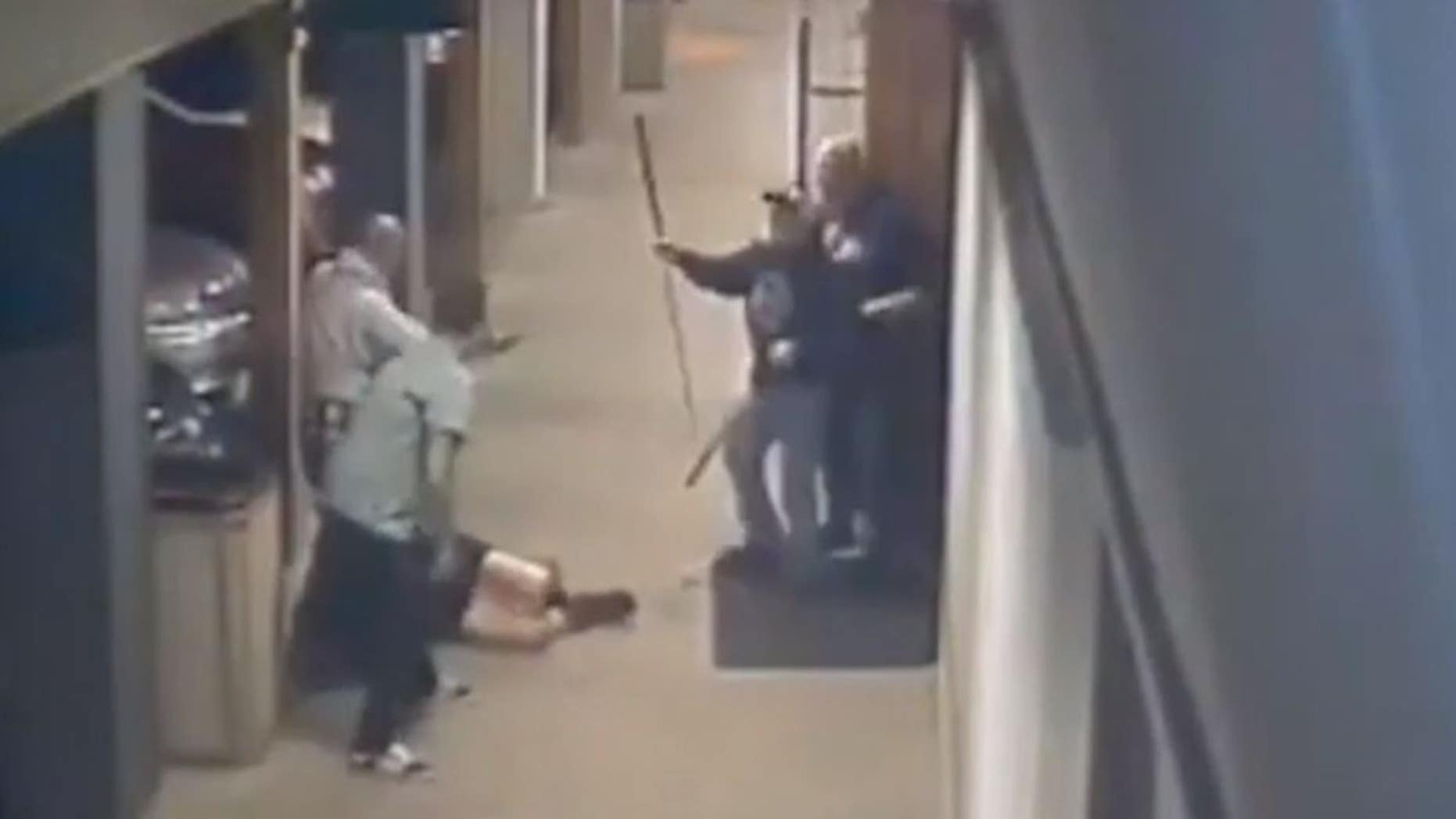 Security camera footage of a Napa, Calif., bar released by police shows two men attacking a woman while other patrons try to intervene.