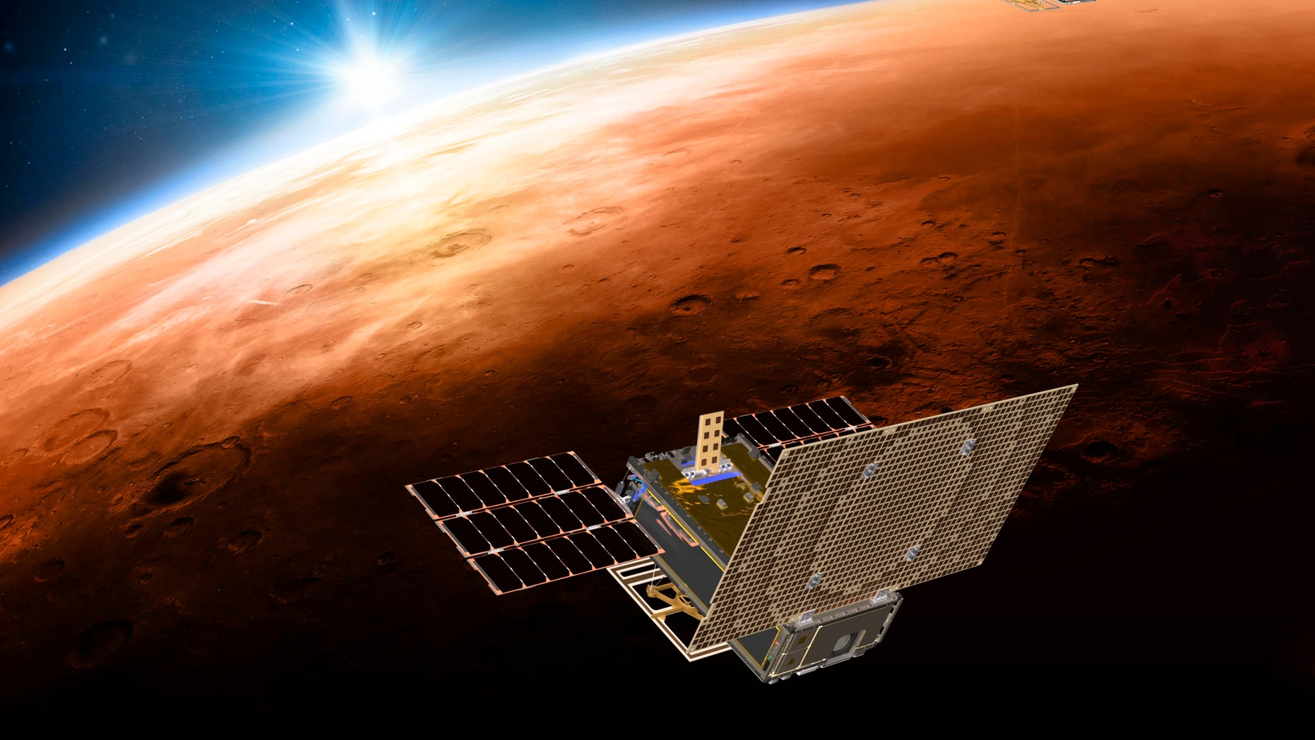 FILE - This illustration made available by NASA in March 2018 shows the twin Mars Cube One project (MarCO) spacecrafts flying over Mars with Earth and the sun in the distance. (NASA/JPL-Caltech via AP)