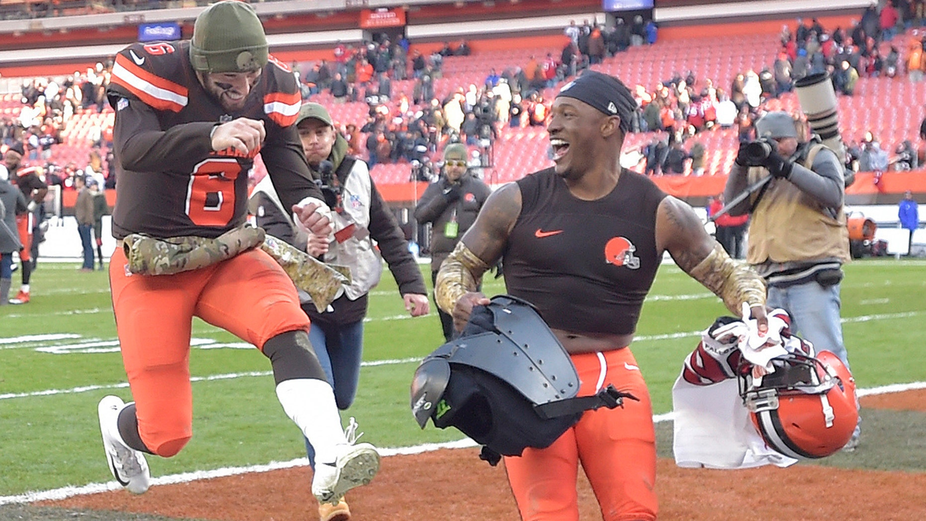 Browns' Damarious Randall handed the ball to Hue Jackson after an interception