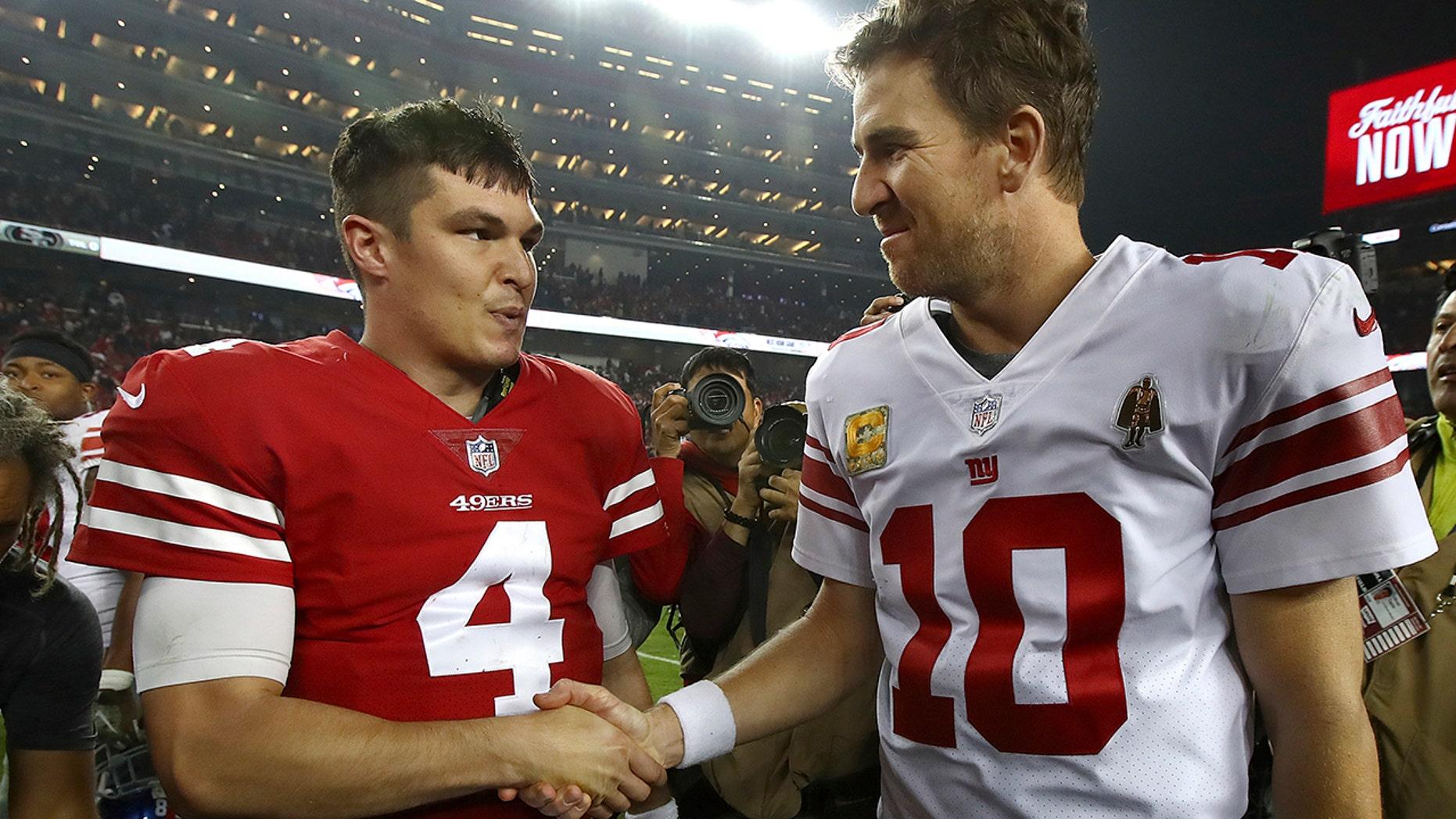 San Francisco 49ers quarterback Nick Mullens (4) shakes hands with New York Giants quarterback Eli Manning (10) after an NFL football game in Santa Clara, Calif., Monday, Nov. 12, 2018.