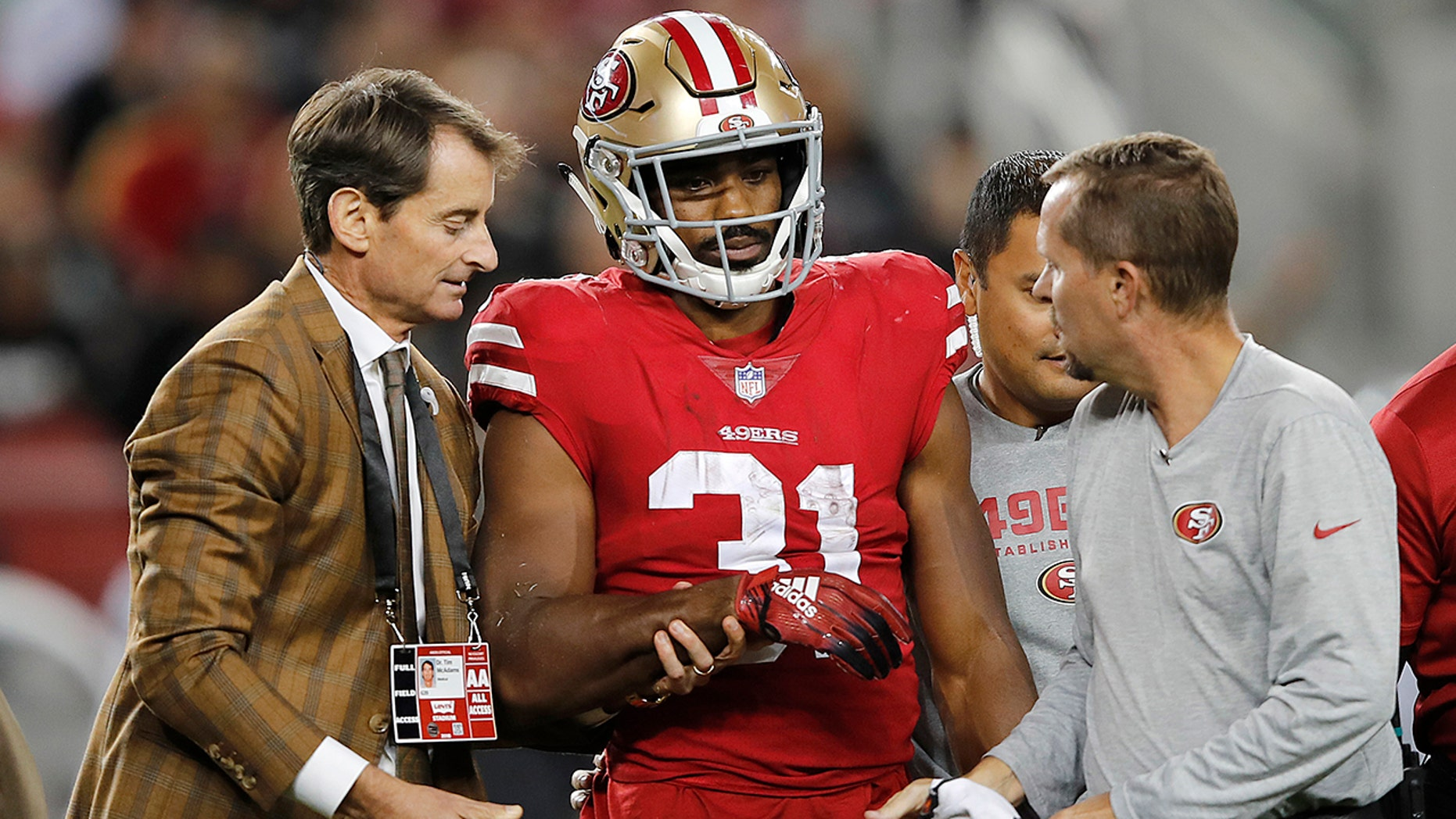 San Francisco 49ers running back Raheem Mostert (31) walks off the field with trainers during the second half of the team's NFL football game against the Oakland Raiders in Santa Clara, Calif., Thursday, Nov. 1, 2018.