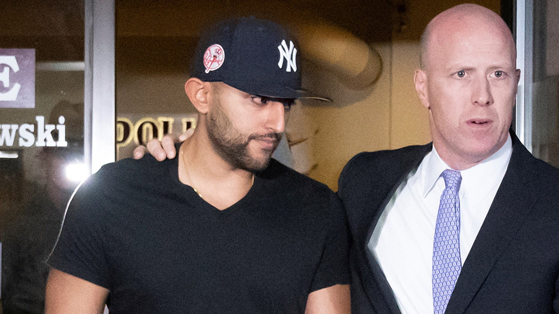 Nauman Hussain, left, operator of a limousine company that owned the vehicle involved in a crash that killed 20 people in upstate New York, leaves with his lawyer Lee Kindlon after posting bond at Cobleskill Town Court in Cobleskill, N.Y., Oct. 10, 2018. (Reuters)