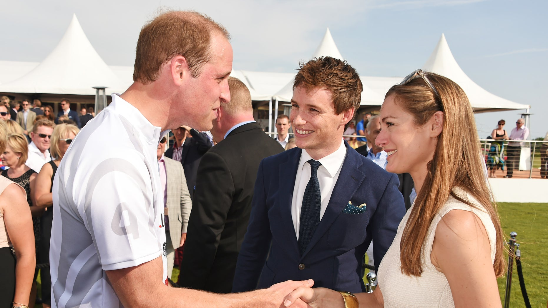 Prince William, left, Eddie Redmayne and Hannah Bagshawe attend the Audi Polo Challenge 2015 at Cambridge County Polo Club on July 3, 2015 in Cambridge, England.