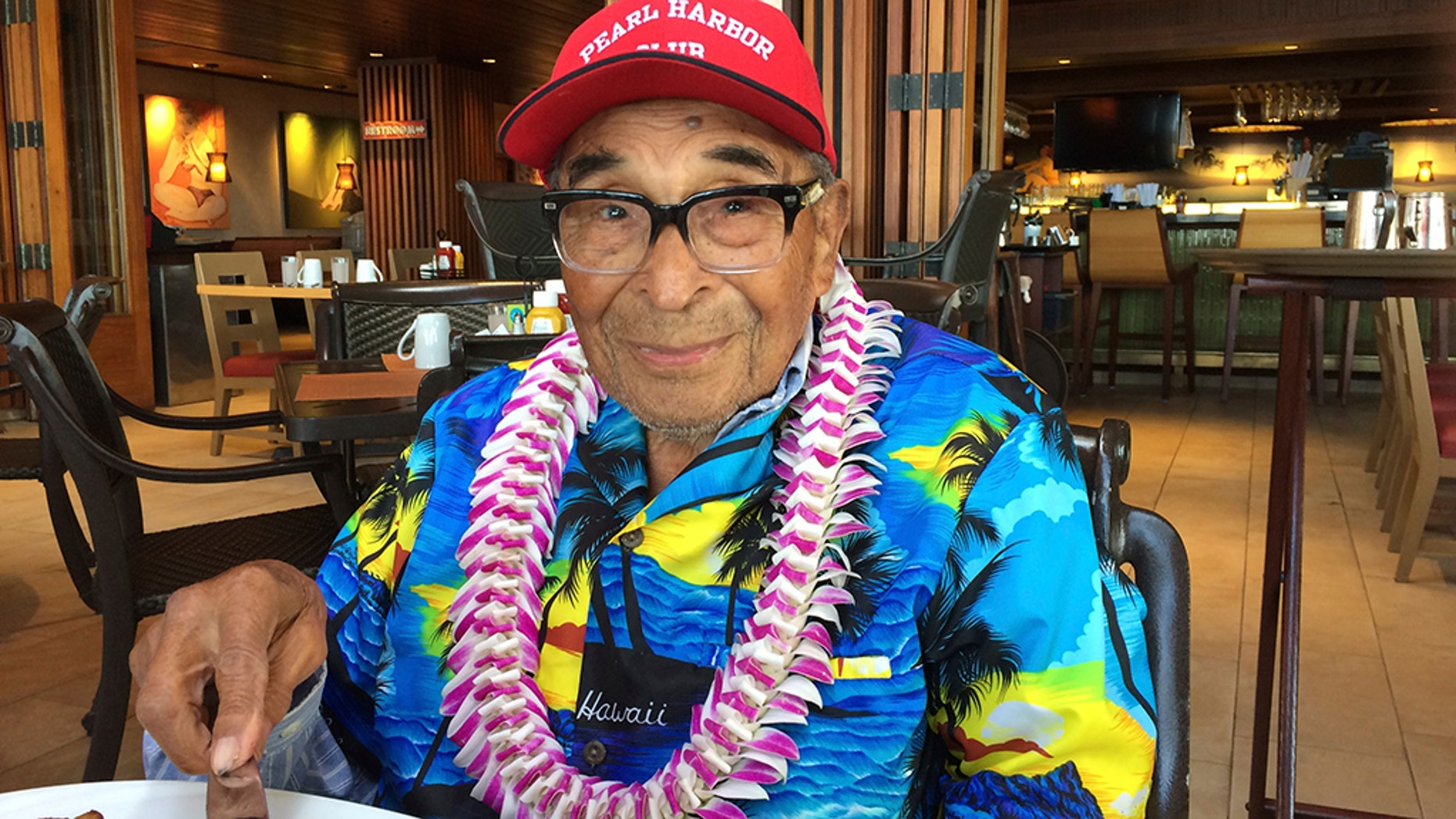 In this Dec. 5, 2016, photo, Ray Chavez, a Pearl Harbor survivor from Poway, California, pauses while eating breakfast in Honolulu. Chavez was out on a minesweeper, the Condor, before the attack. Chavez is among a few dozen survivors of the Japanese attack on Pearl Harbor who planned to gather at the Hawaii naval base two days later to remember those killed 75 years earlier. (AP Photo/Audrey McAvoy)
