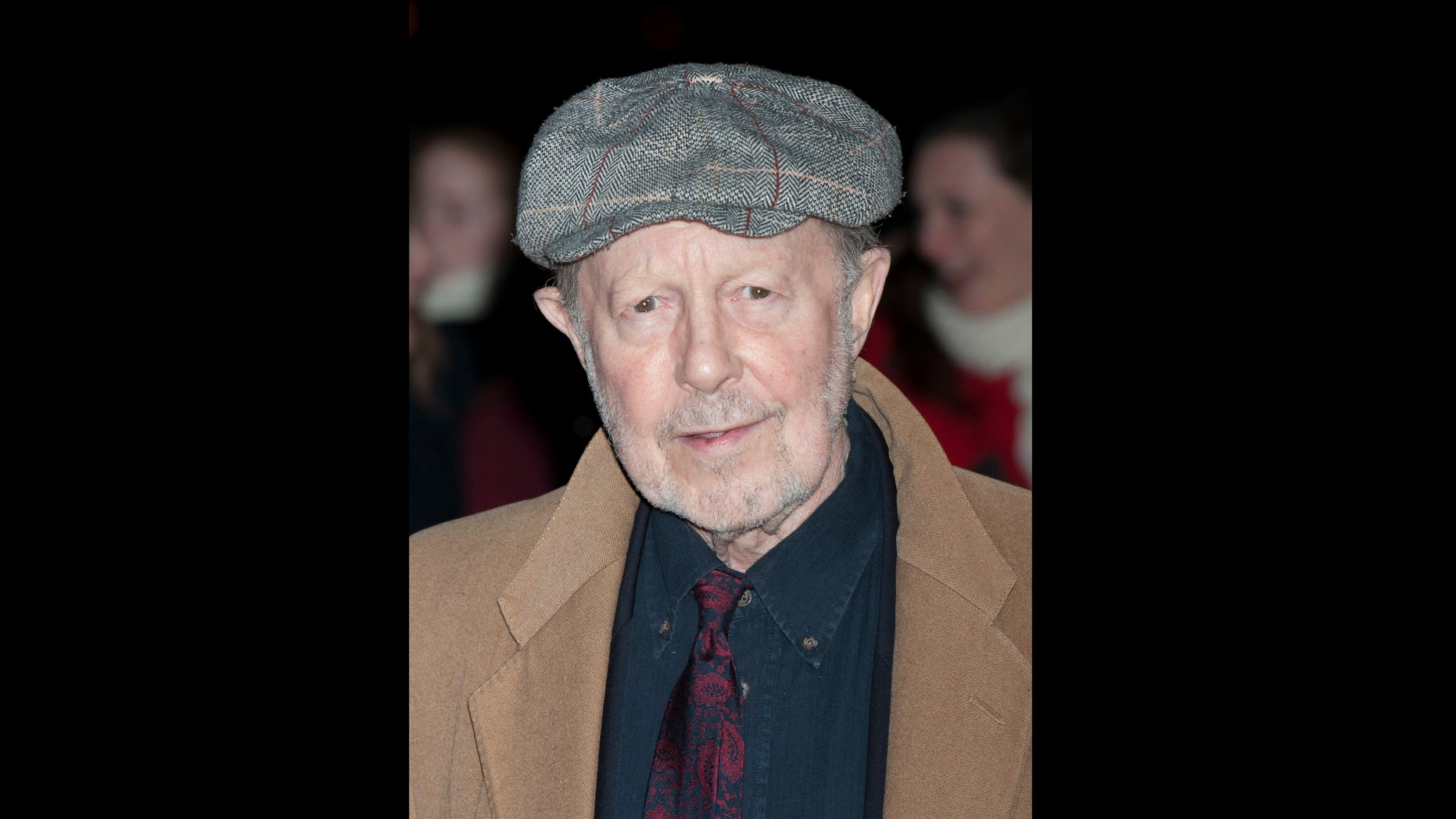 FILE - On this file photo of Thursday, January 19, 2012, Nicolas Roeg arrives for the Film Critics Circle Awards in a central London event. The son of Nicolas Roeg says that the prominent British director has died. He was 90. Nicolas Roeg Jr. told the British press association that the director of