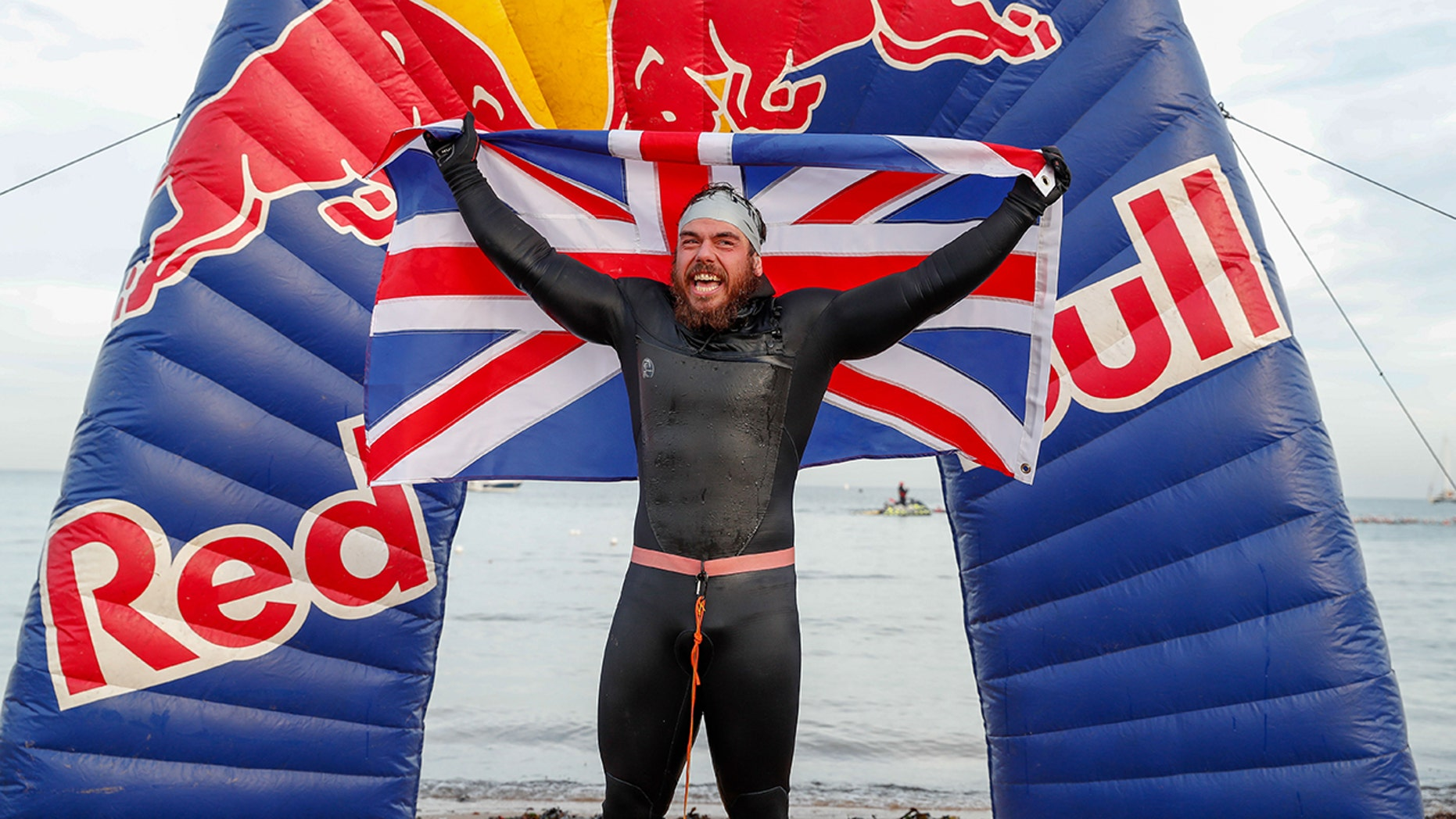 Ross Edgley of England celebrates finishing his 'Great British Swim', a historic nearly 2,000 mile swim around Great Britain. (Photo by Luke Walker/Getty Images for Red Bull)