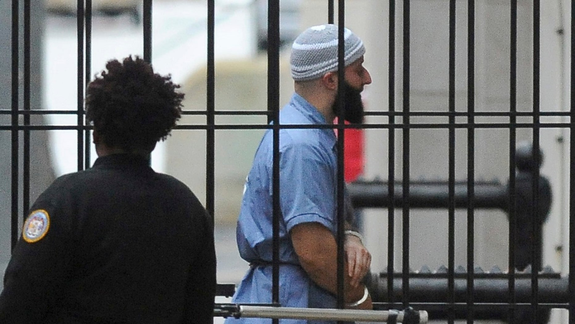 Adnan Syed enters Courthouse East prior to a hearing in Baltimore.
