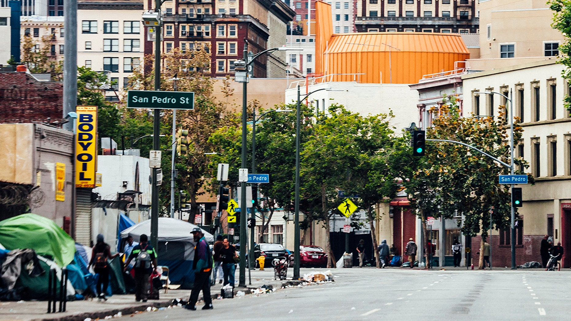 Los Angeles prosecutors say a voter fraud scheme has been uncovered in which homeless on Skid Row were being offered cash and cigarettes in exchange for their signatures.