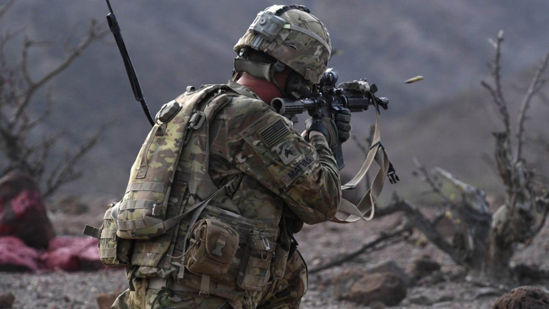 File photo - A 10th Mountain Division Soldier fires an M4 rifle during a platoon Situational Training Exercise at a range in Arta, Djibouti, Aug. 25, 2018.
