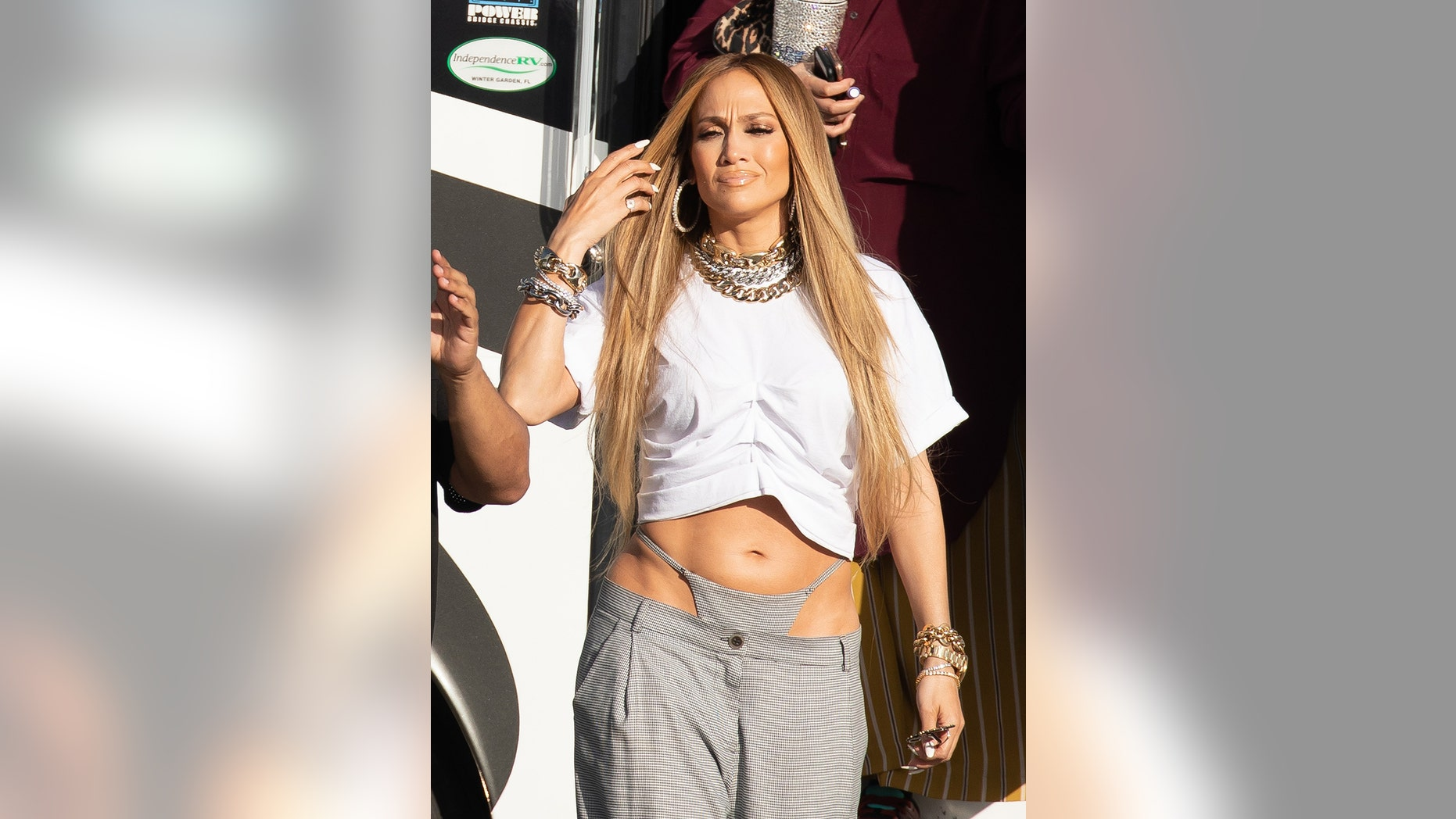 Jennifer Lopez matches her thong to her baggy pants as she shoots a music video with DJ Khaled in Miami.
