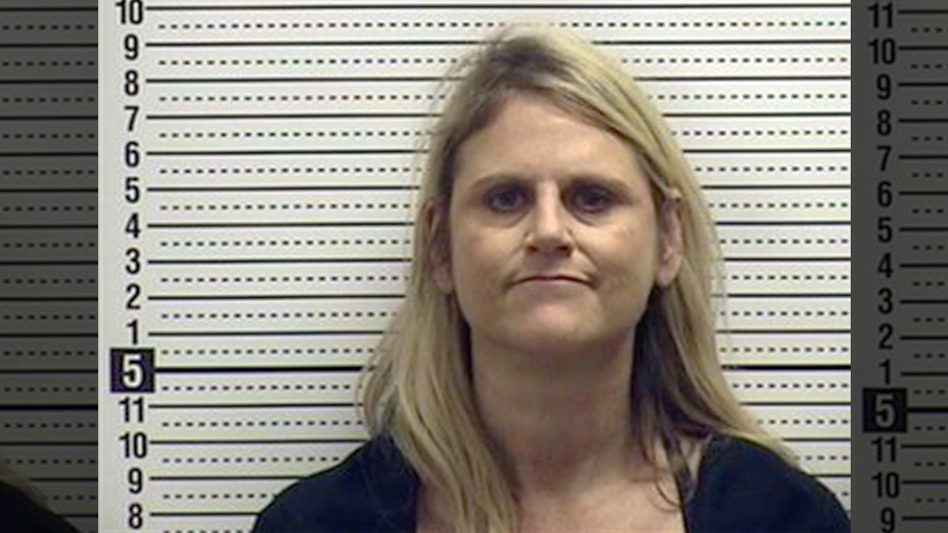 Susan Westwood, 51, reportedly turned herself in to police in Sunset Beach, Nort Carolina on Saturday after she was seen ranting racist remarks in a viral video.