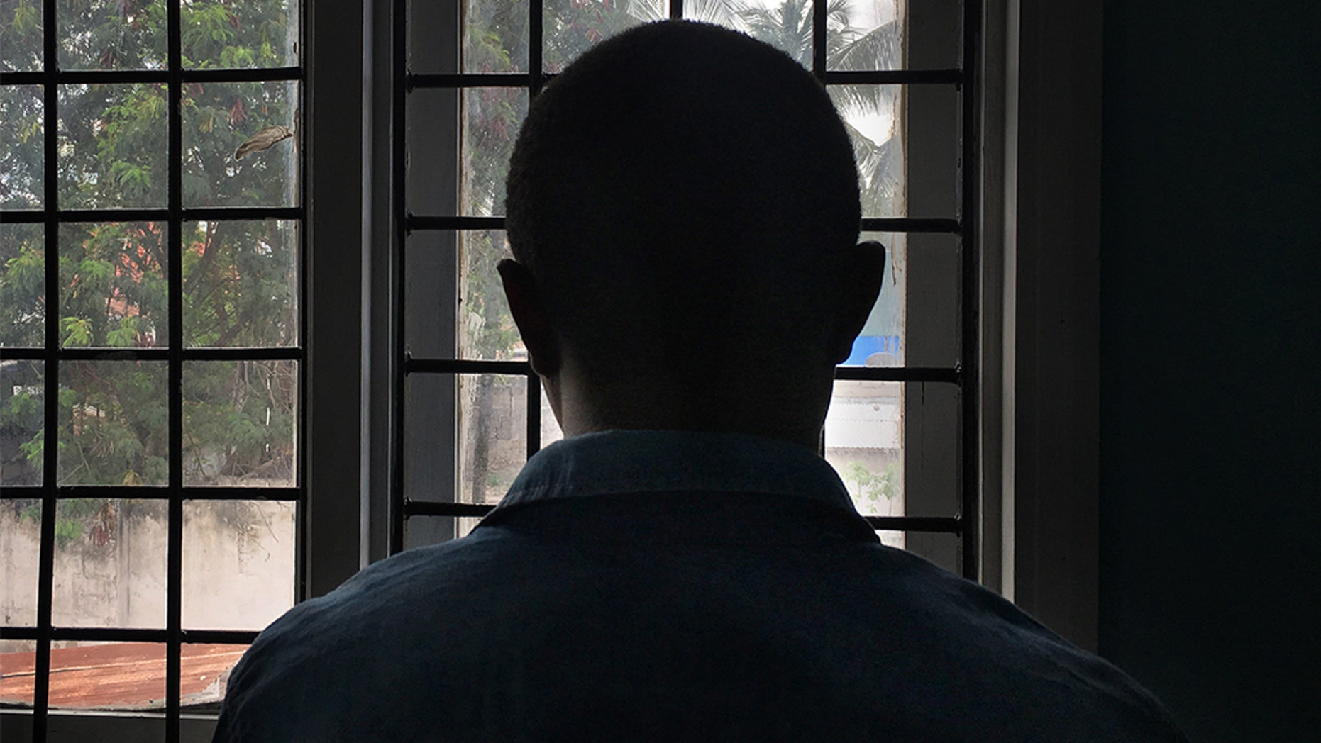 A gay man with HIV stands in a clinic in Dar es Salaam, Tanzania in this 2016 photo.