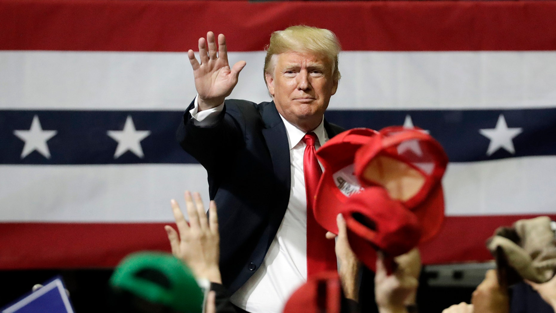 FILE -- President Donald Trump acknowledges the crowd as he leaves a rally Sunday, Nov. 4, 2018, in Chattanooga, Tenn. (AP Photo/Mark Humphrey)