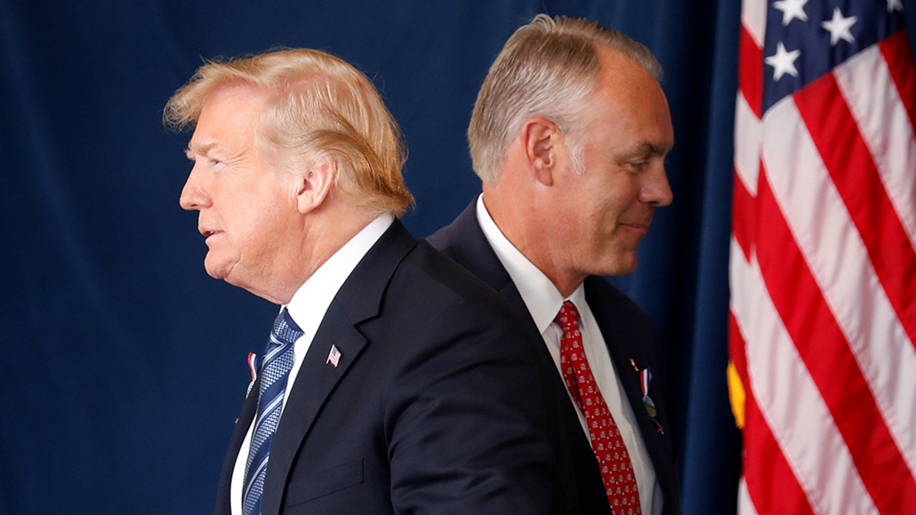 President Trump walks past Interior Secretary Ryan Zinke at a 9/11 observance in Pennsylvania.