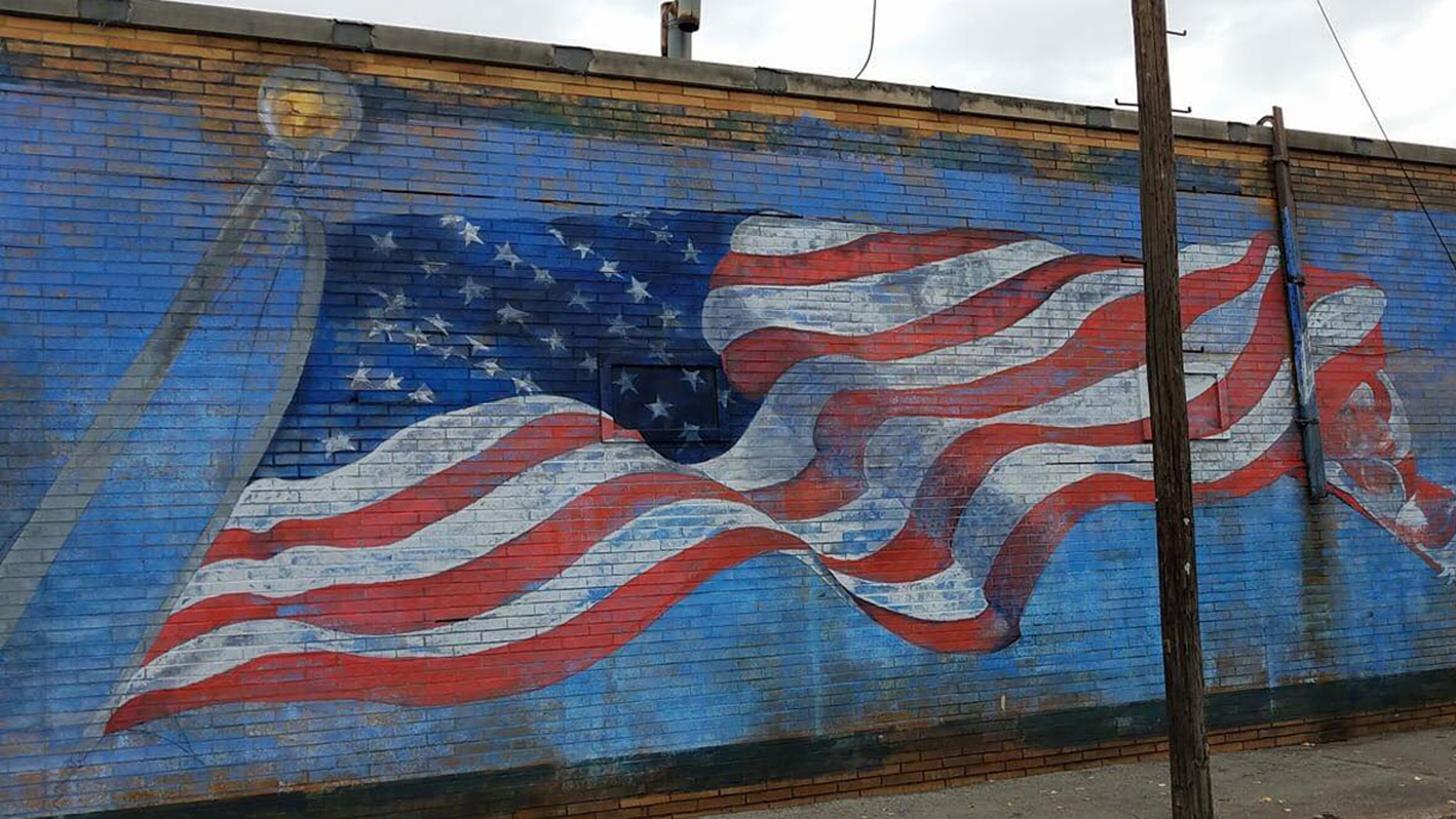 The American flag mural on the side of La Bella Pizza Bistro in New Paltz, NY before it was vandalized Monday night.