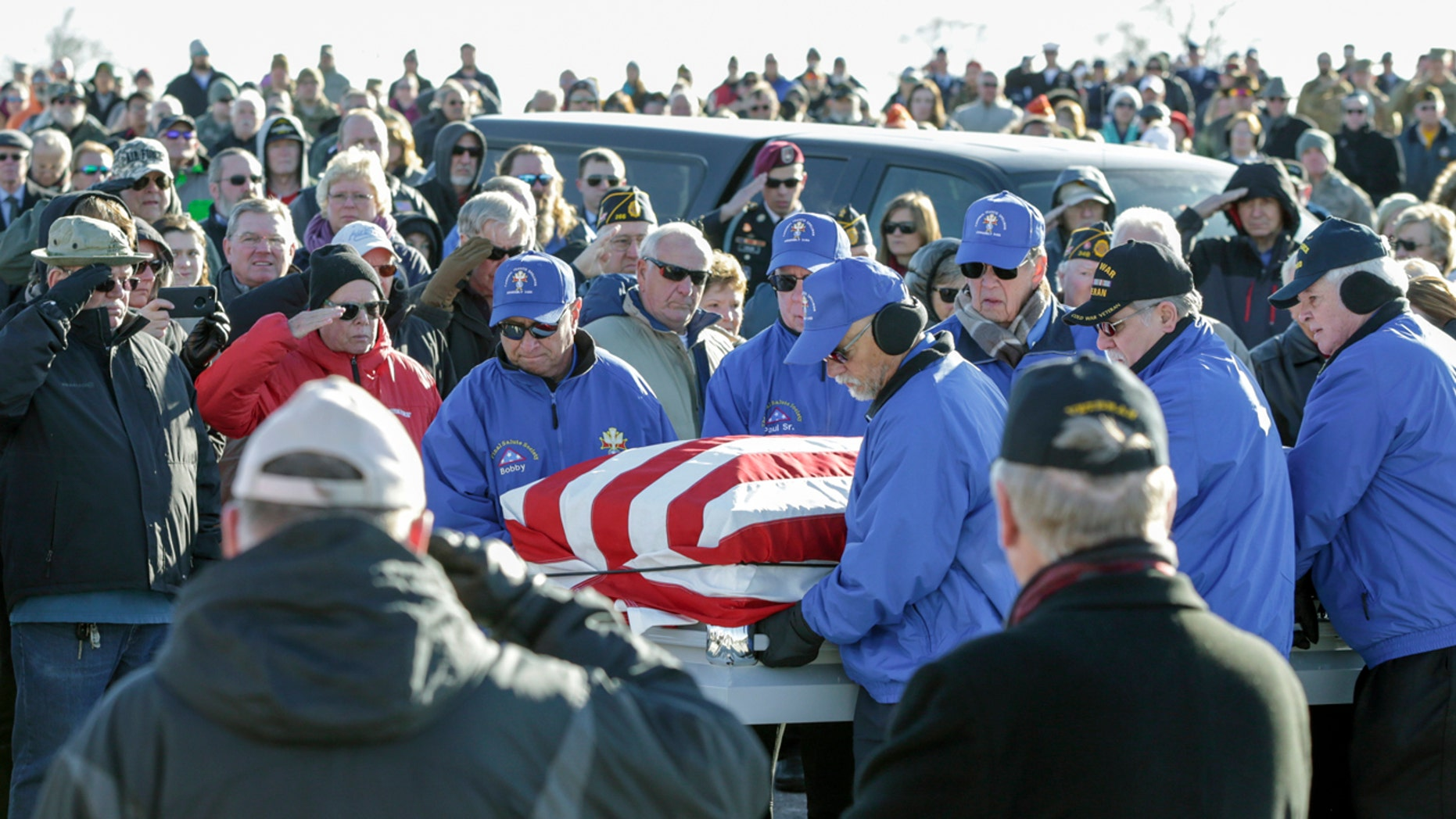 Pallbearers carrying the flag-draped casket of Vietnam veteran Stanley Stoltz at the Omaha National Cemetery on Tuesday. (AP Photo/Nati Harnik)