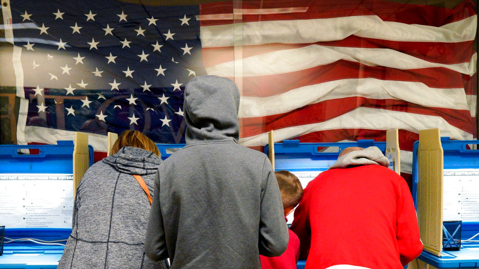 FILE- In this Nov. 2, 2018, file photo residents vote early at the Douglas County Election Commission office in Omaha, Neb. (AP Photo/Nati Harnik, File)