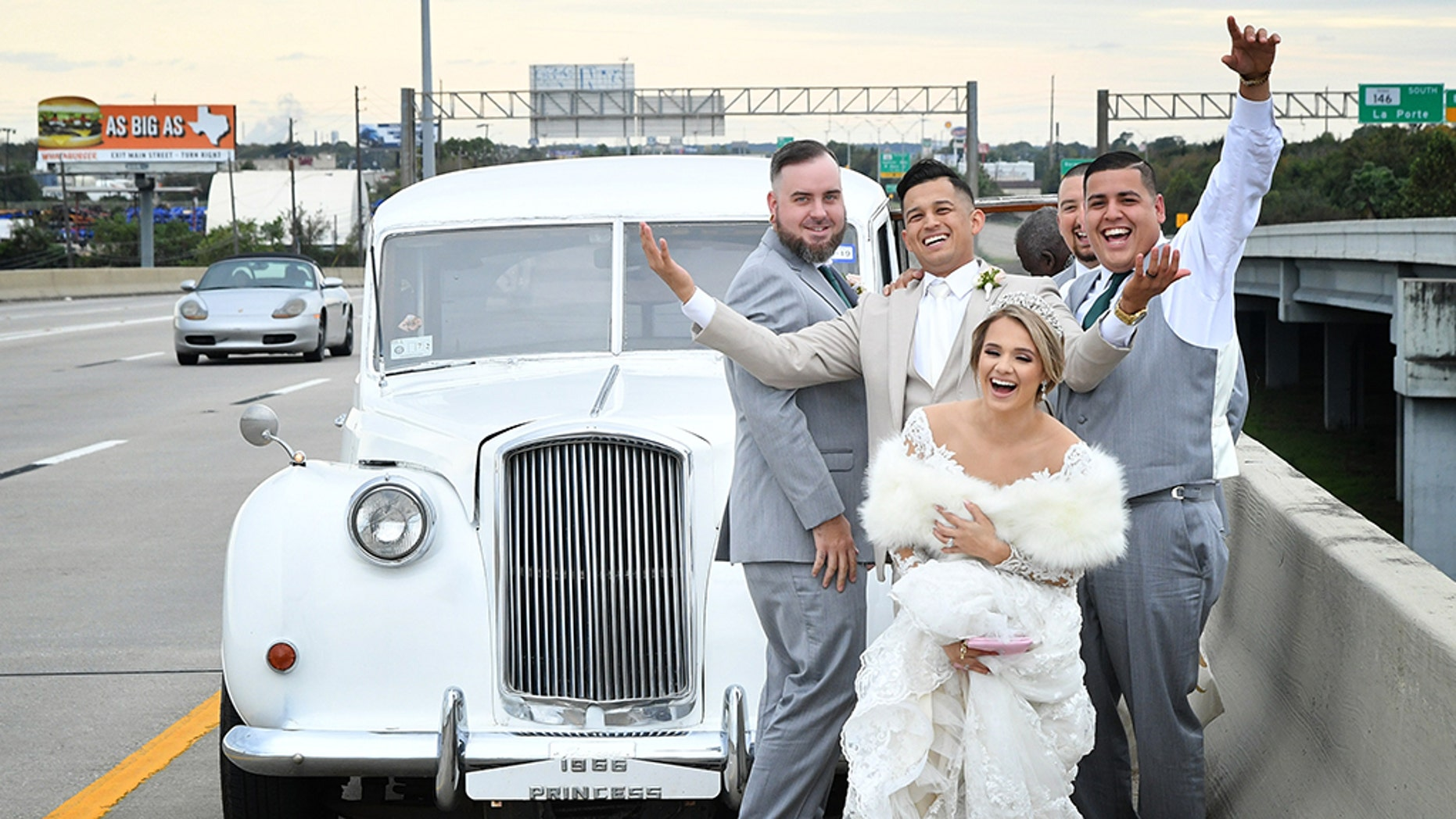 A newlywedcouple's car broke down on their way to the reception and they ended up with this funny picture to remember the moment.