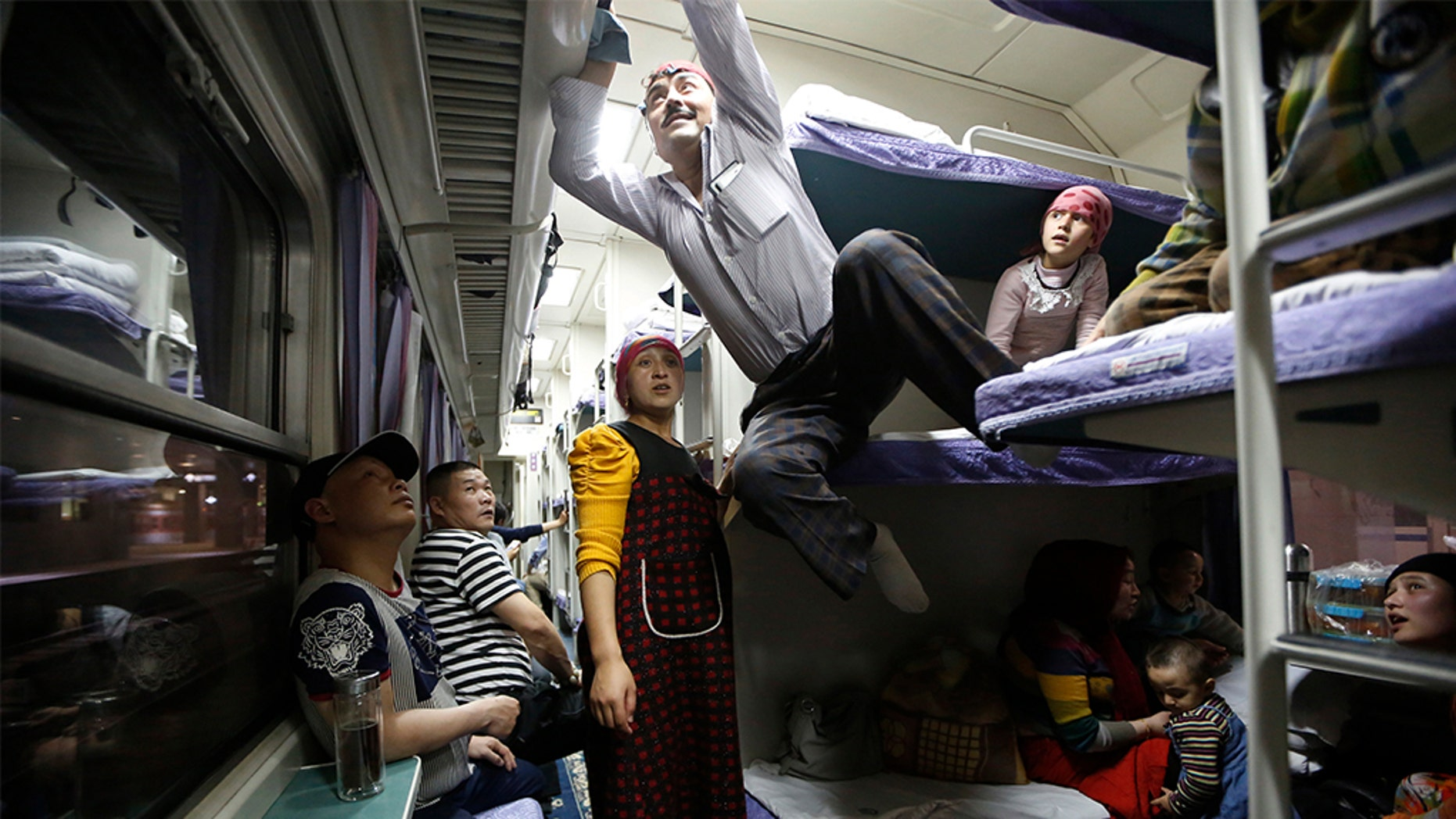 A Uighur group traveling on a train to Xingjiang, in Shanghai, May 14, 2014. (REUTERS/Aly Song, File)
