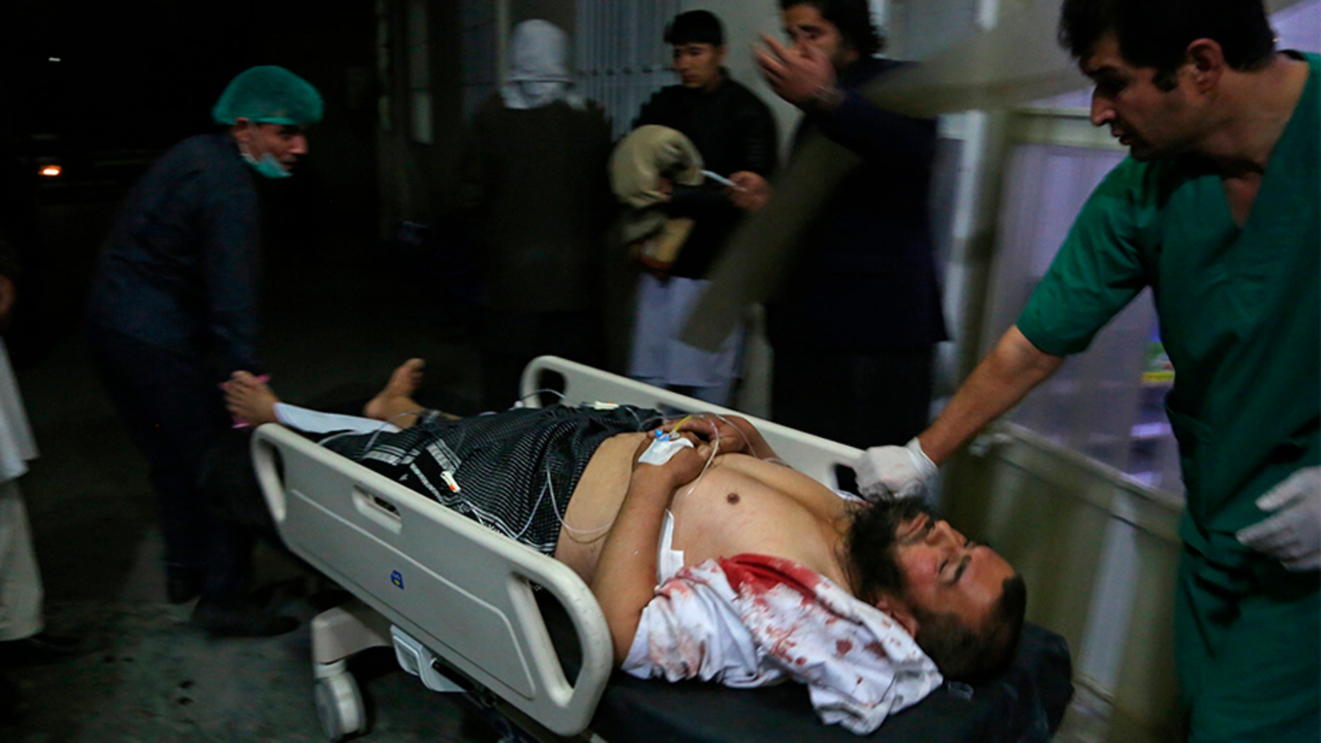 A man injured in a suicide bombing Monday is brought into a hospital in Kabul, Afghanistan.