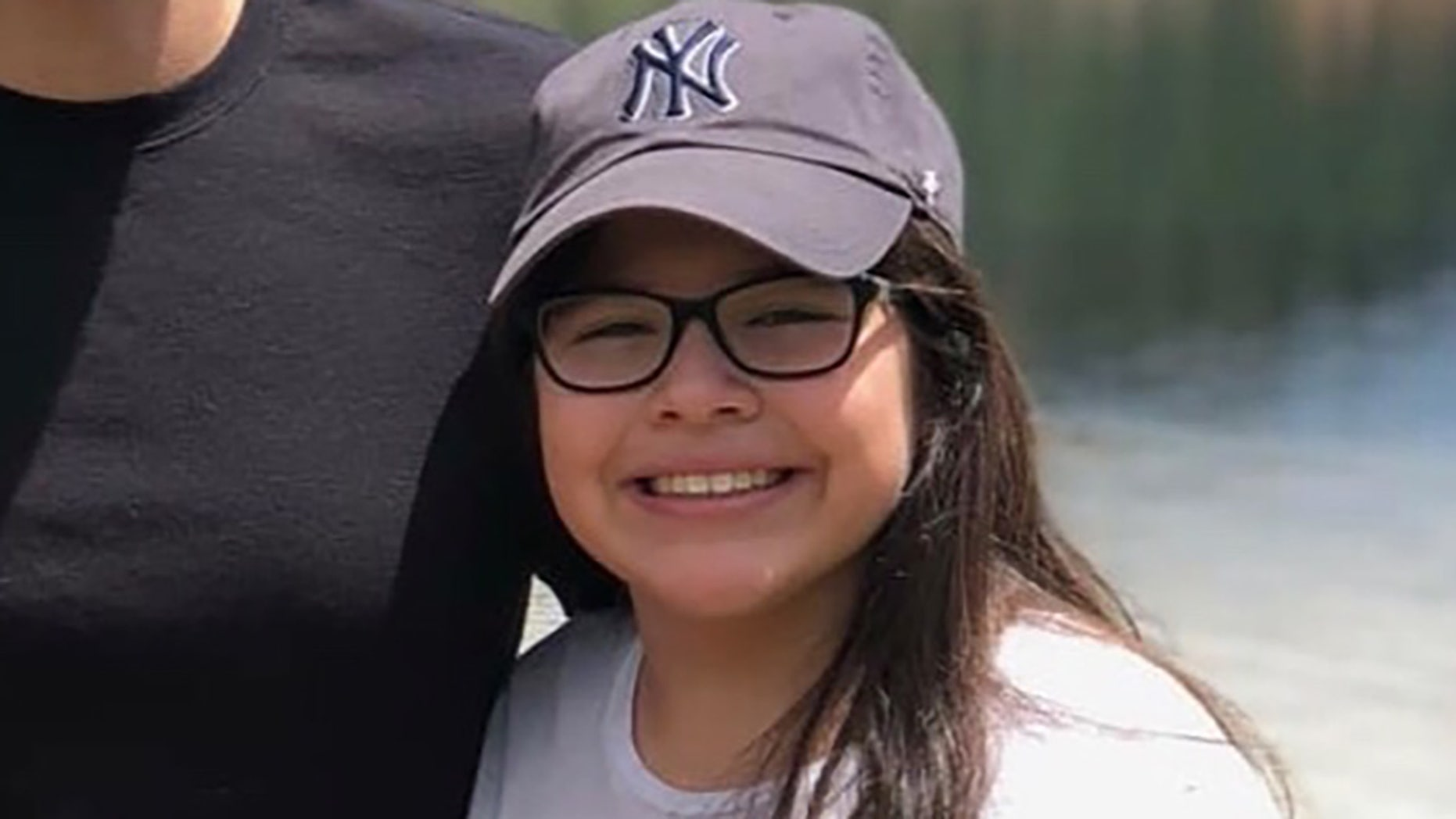 Angie Erives, 11, was fatally shot while seated in the kitchen of her family's North Las Vegas home Thursday night when shooters intent on gang-related retaliation targeted the wrong house, police said.